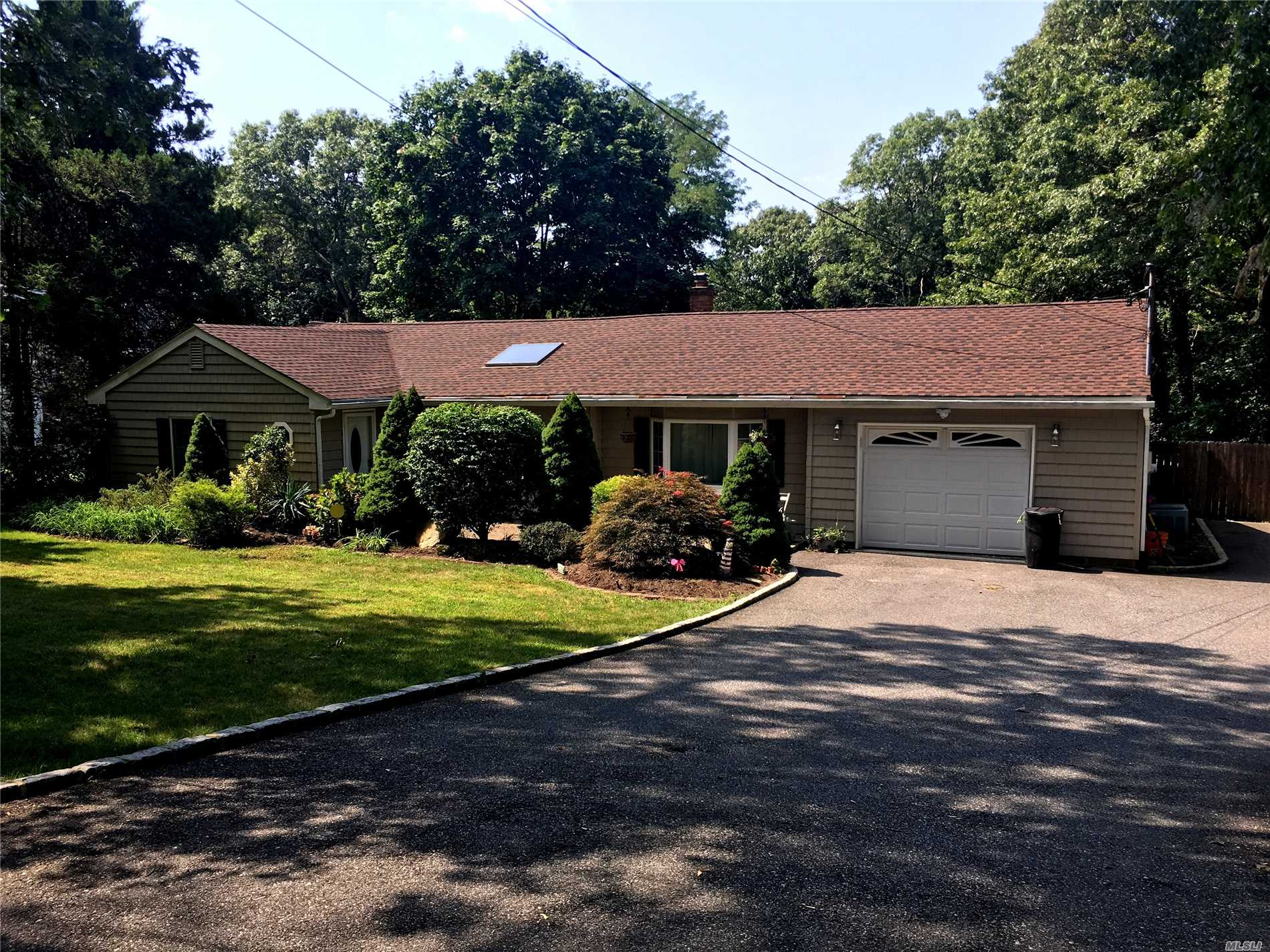 Beautiful Expanded Ranch,  Connetquot School District,  Bi Level Trex Deck Overlooking Huge Backyard,  New Heating System And Hot Water Heater,  200 Amp Electric,  Updated Kitchen With Ss Appliances, Wood Floors Throughout, Updated Baths, Crown Molding, High Hats, Built In Shelving, Finished Basement, Leased Solar Panels, In-Ground Sprinklers, Taxes With Basic Star $8, 290.85. Propane Used For Stove And Dryer