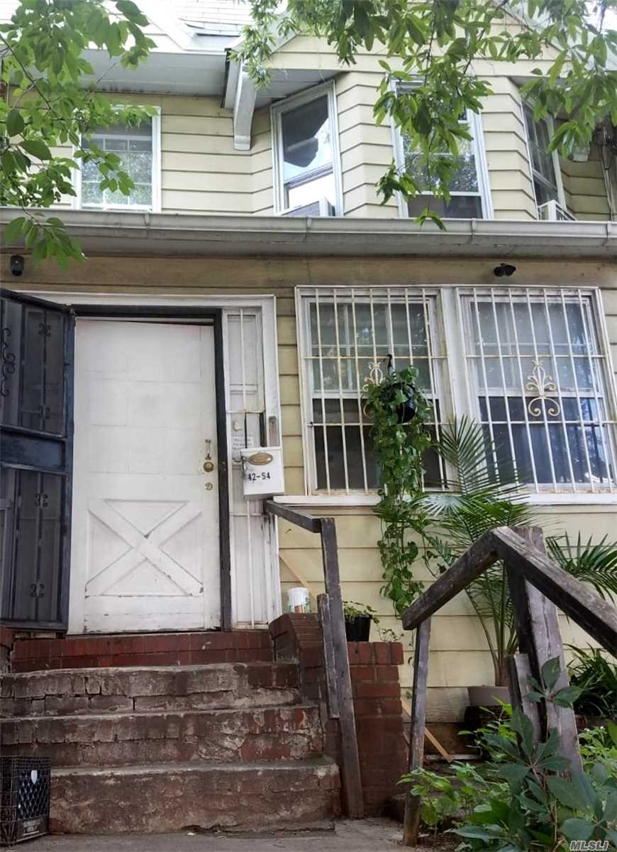 Attached Single Family House With Full/Unfinished Basement Located In The Elmhurst Section Of Queens. Property Features A Living Room/Dining Room Combination, Kitchen, Three Bedrooms, And Two Bathrooms.