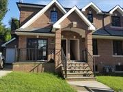 Brick 2 Family In Prime Location,  Walk To Lirr, Custom Design Contemporary Style, Beautiful Oak Wood Floor, Luxury Material & Appliance, Cac, High Ceiling Huge Basement, Detached Garage, Long Driveway. Legal 2 Family