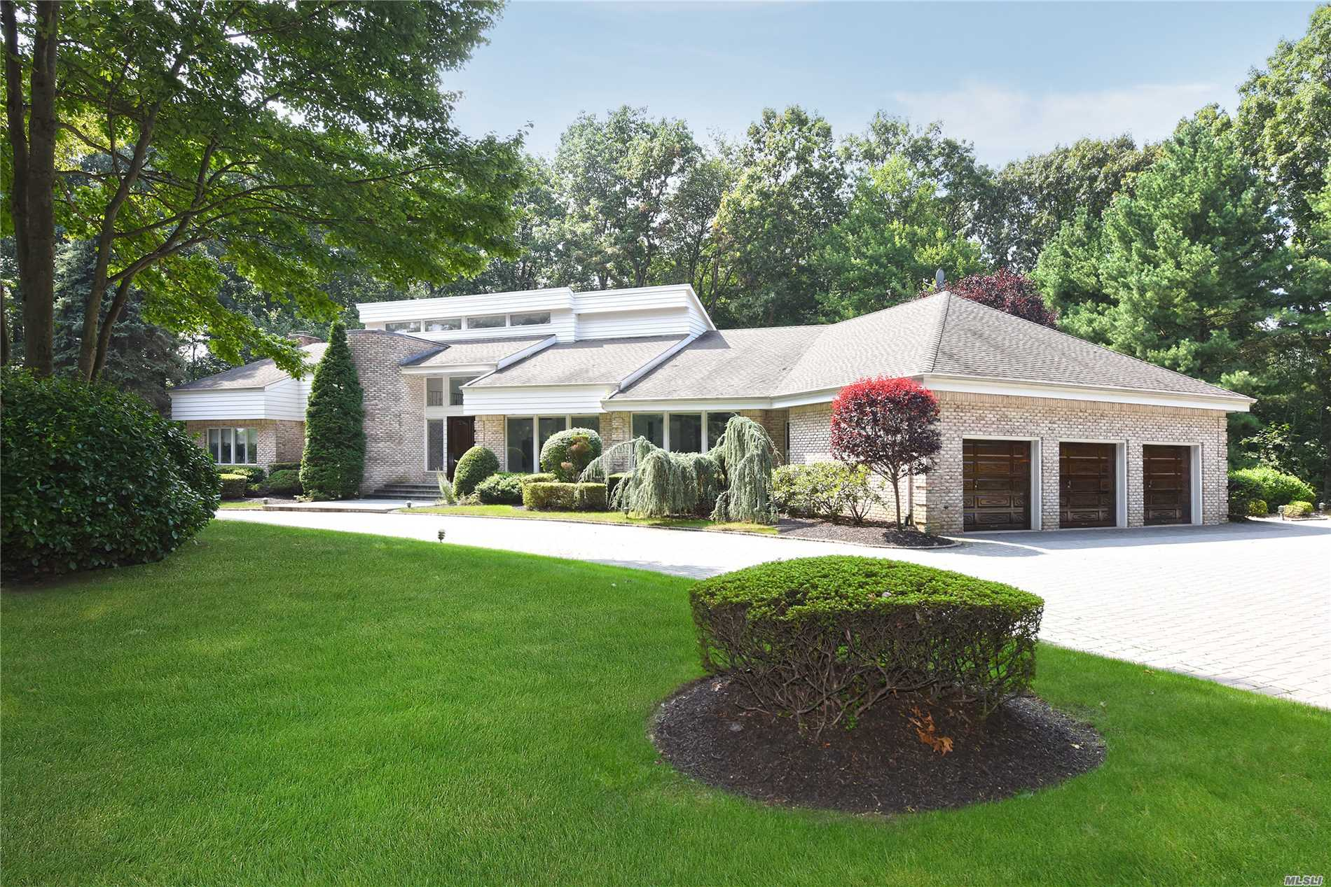 Serenely Set On 2.3 Acres In The Estate Area Of Upper Brookville. This Custom Built Ranch Style Residence Features A Thoughtfully Designed Layout Allowing For Easy One Floor Living. The Den Is An Impressive Showcase Inspired By European Libraries. The Graceful Staircase Ascends To Additional Bedrooms. Imported Materials, Marble Bath, Steam Shower, Sauna And More In A Spacious Master Suite. Newly Installed Paver Driveway, 3-Car Garage, Sewers, Generator And Security Cameras Are Just More Perks.