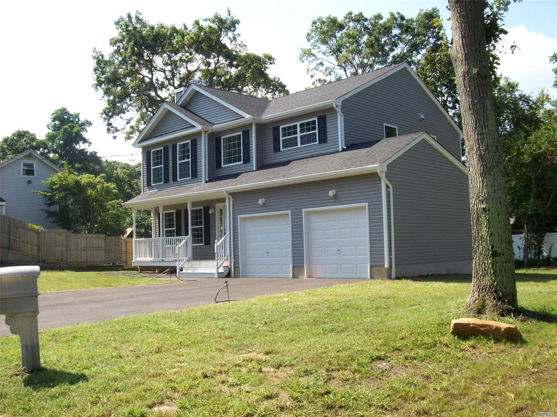 New 4 Bed Rm 2.5 Bath Colonial With A 2 Car Garage In Miller Place School District. $35, 000.00 Upgrade Pkg Incl In List Price. Pkg Includes 2nd Car Garage, Andersen Windows & Sliding Door. Recessed Lights. Central Air, #1 Oak Hardwood Floors And Railings, Fireplace, 200 Amp Elec. U Shape Kitchen With Granite Counter, Full 850 Sq Ft Basement With Outside Entrance. 2 Story Foyer. Taxes Shown Are For Land Only And Will Be Reassessed. True Taxes Tbd