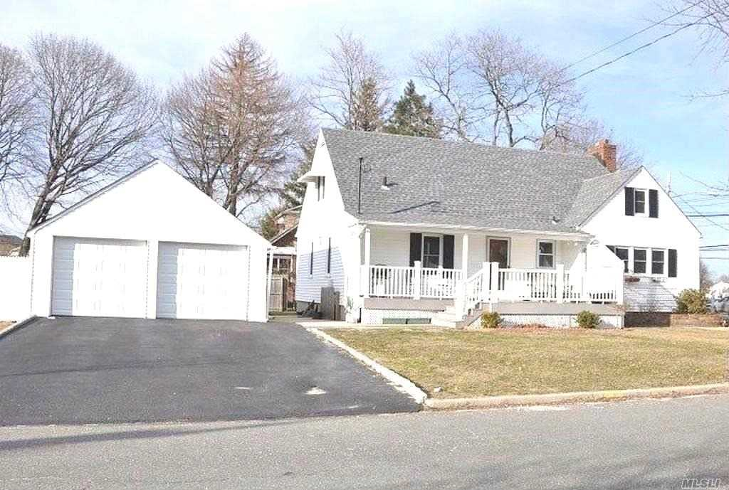 This Charming Cape Sits In A Convenient Location W/ Easy Access To Town, The Lirr Station, Rt. 110, Southern Pkwy, And Shopping. Woodward Schools. Features An Updated Kitchen With Granite Countertops, Formal Dining Room, Family Room With Wood Burning Fireplace, Young Roof, Updated Electric, Hard Wood Floors, Large Side Porch And A Two Car Garage. Gas In The House.