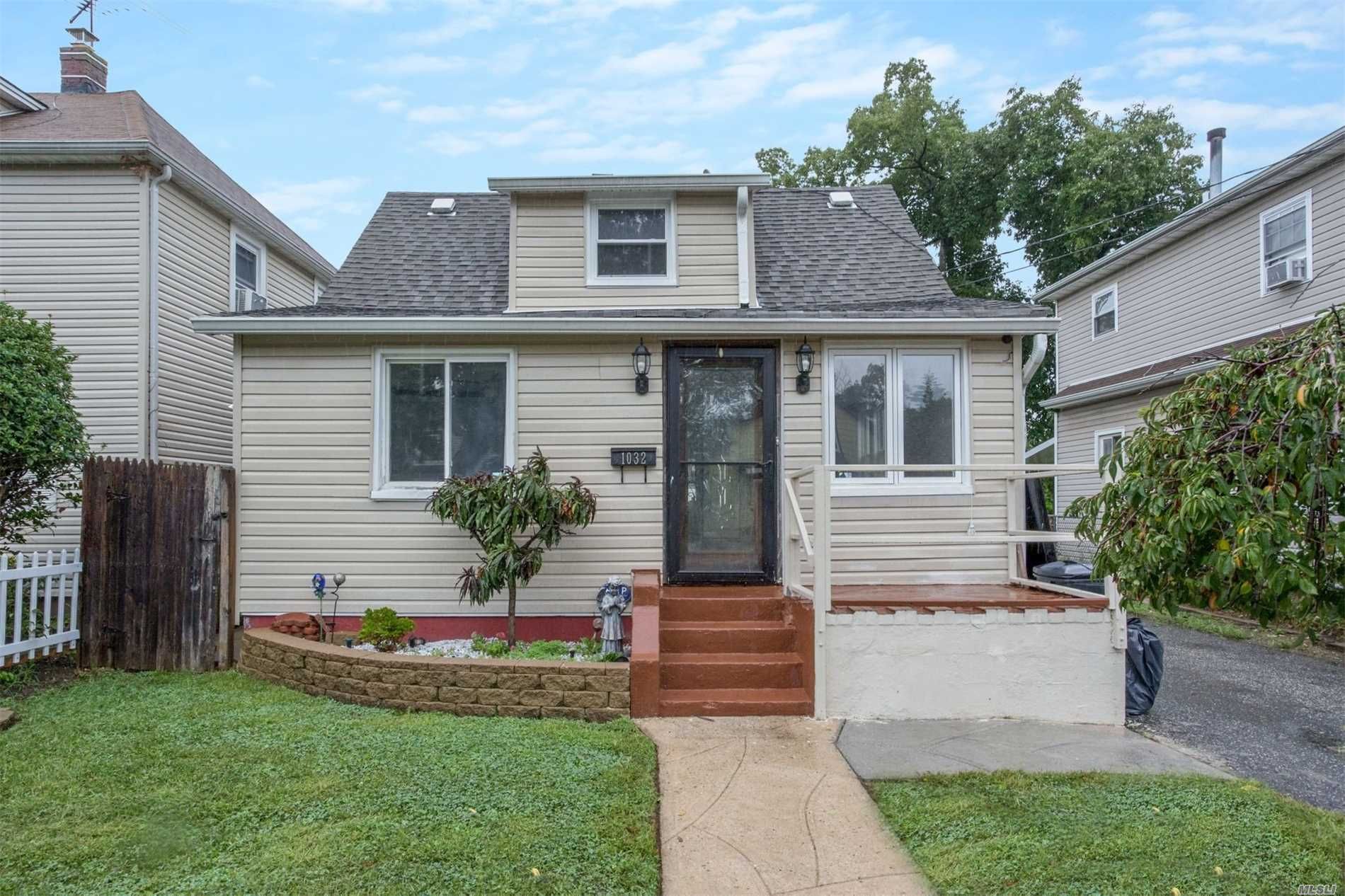 Uniondale Cape Home With 4 Bedrooms, 1 Full Bath, Eat In Kitchen, Living Room Dining Room Combo With Hard Wood Floors. Finished Basement With Side Entrance. Private Driveway.