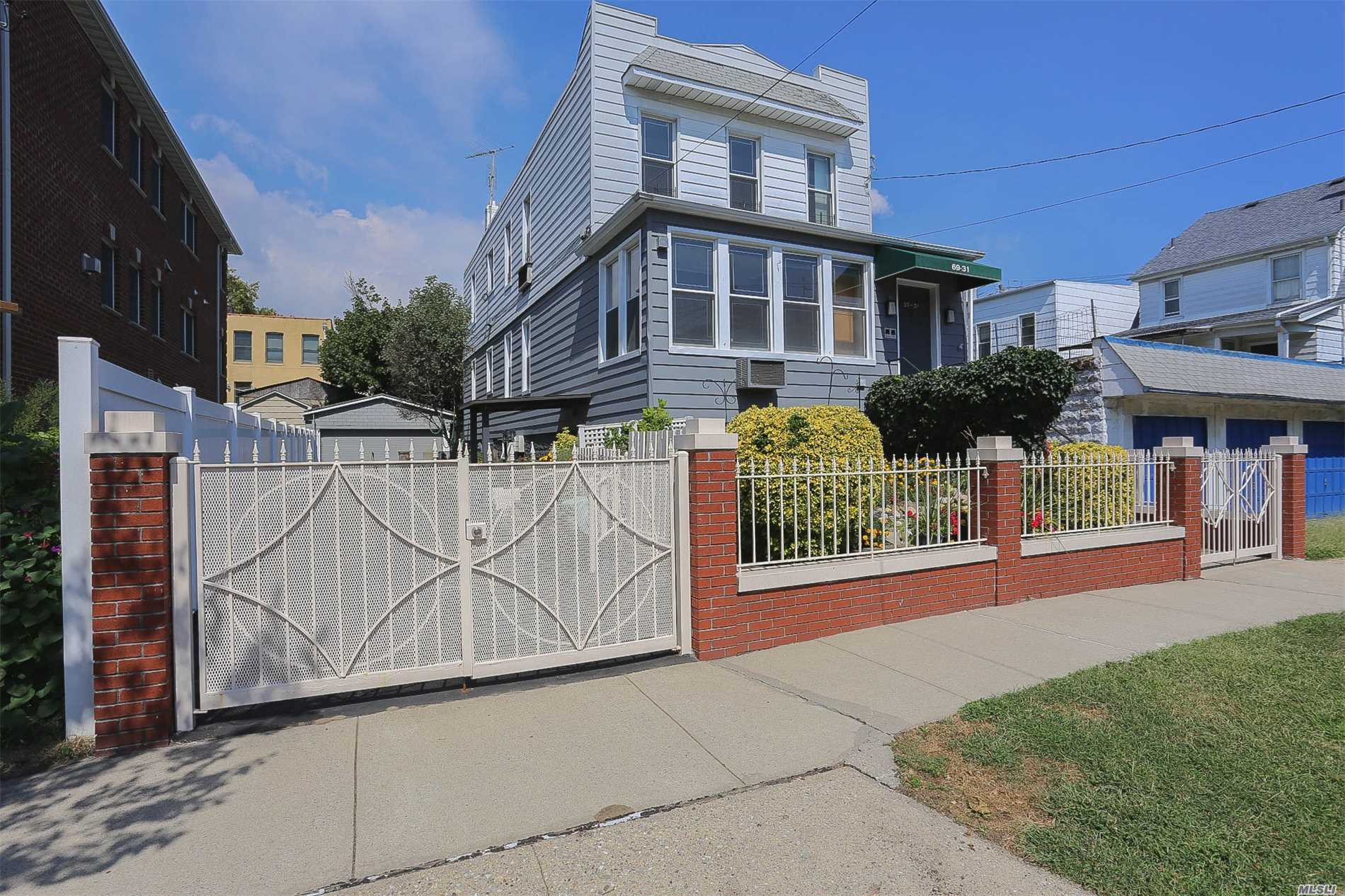 Fully Det 2 Fam Home Sitting On Over-Sized 40 X 100 Lot. Located On A Beautiful Block Right On The Border Of Maspeth/Middle Village. House Feat 2, 060 Sqft Of Living Space Along Wth A Full Finished Bsmnt (Wth Sep Entrance), Det 2 Car Garage, Pvt Backyard, Pvt 4 Car Driveway. 2nd Flr Feat 2 Bdrms, Large Eat-In-Kitchen, Full Bth, Spacious Living Rm Wth Alcove. 1st Flr Feat 2 Bdrms, One Wall Kitchen, Full Bth, Large Bonus Rm, Spacious Living Room, And Enclosed Porch.