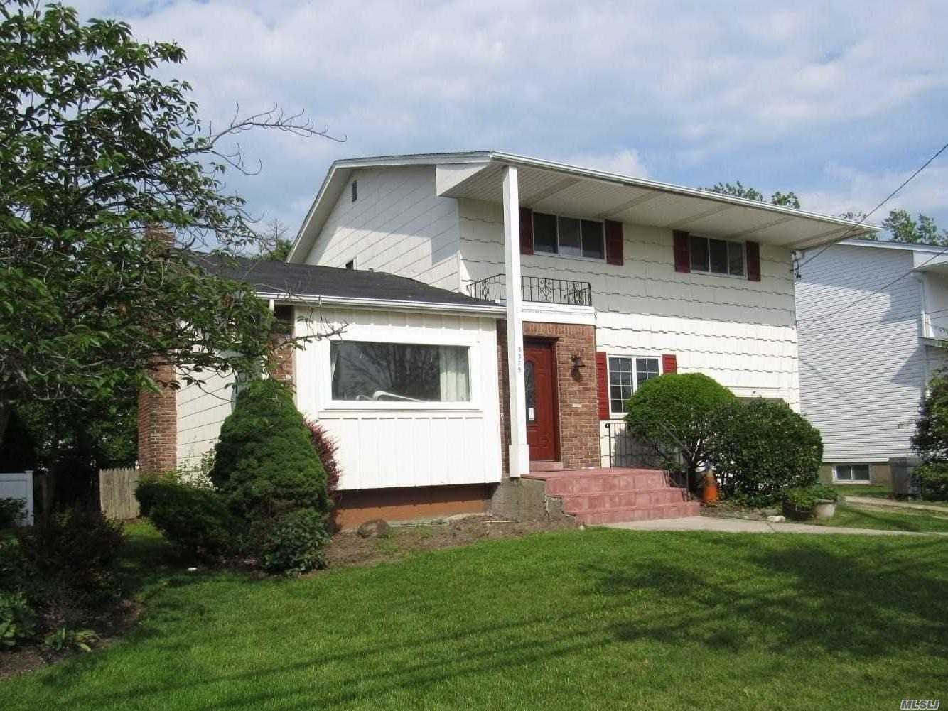 4 Bedroom Colonial, .5 Bath, Full Bath With Jacuzzi, Eik With Stainless Steel Appliances, Large Formal Dinning And Living Room, Den With Fireplace And Sliding Glass Doors Leading On To The Deck. Laundry Room, Full Basement, 1 Car Att Garage With Private Driveway.