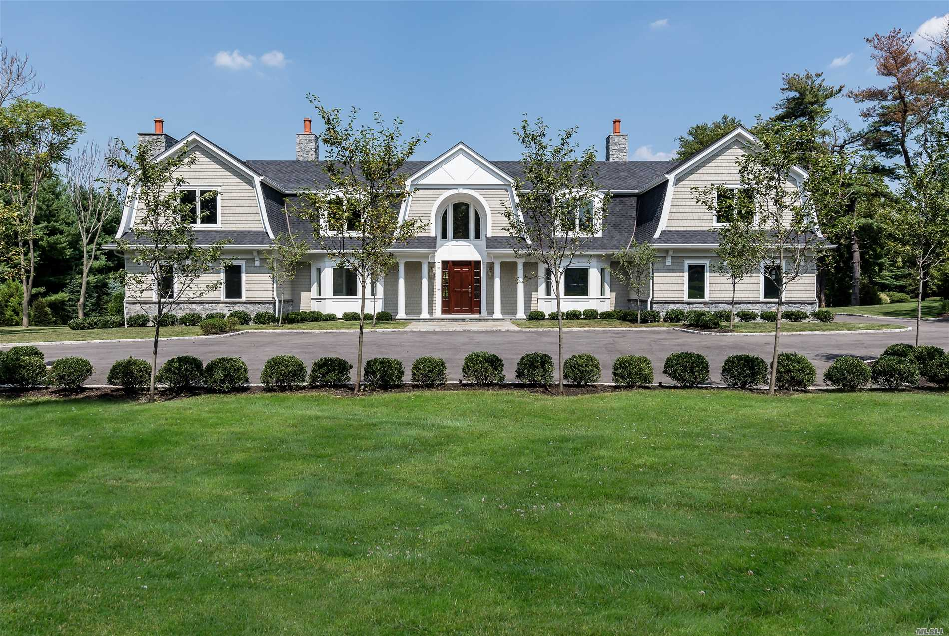 Majestically Situated On The North Shore Of Long Island In A Prestigious Gold Coast Village, This Sophisticated Home Sits On Level Park-Like Grounds In A Tranquil Cul-De-Sac. Natural Stone And Shake Exterior Meet Luxurious Appointments And State Of The Art Amenities. Walking Through This Elegant Home Which Combines Grand Spaces With Intimately Proportioned Private Spaces, You Will Be Warmed By One Of The Three Fireplaces, Sunlit Sumptuous Bedrooms Emulates Serenity, Each With En Suite Marble Baths