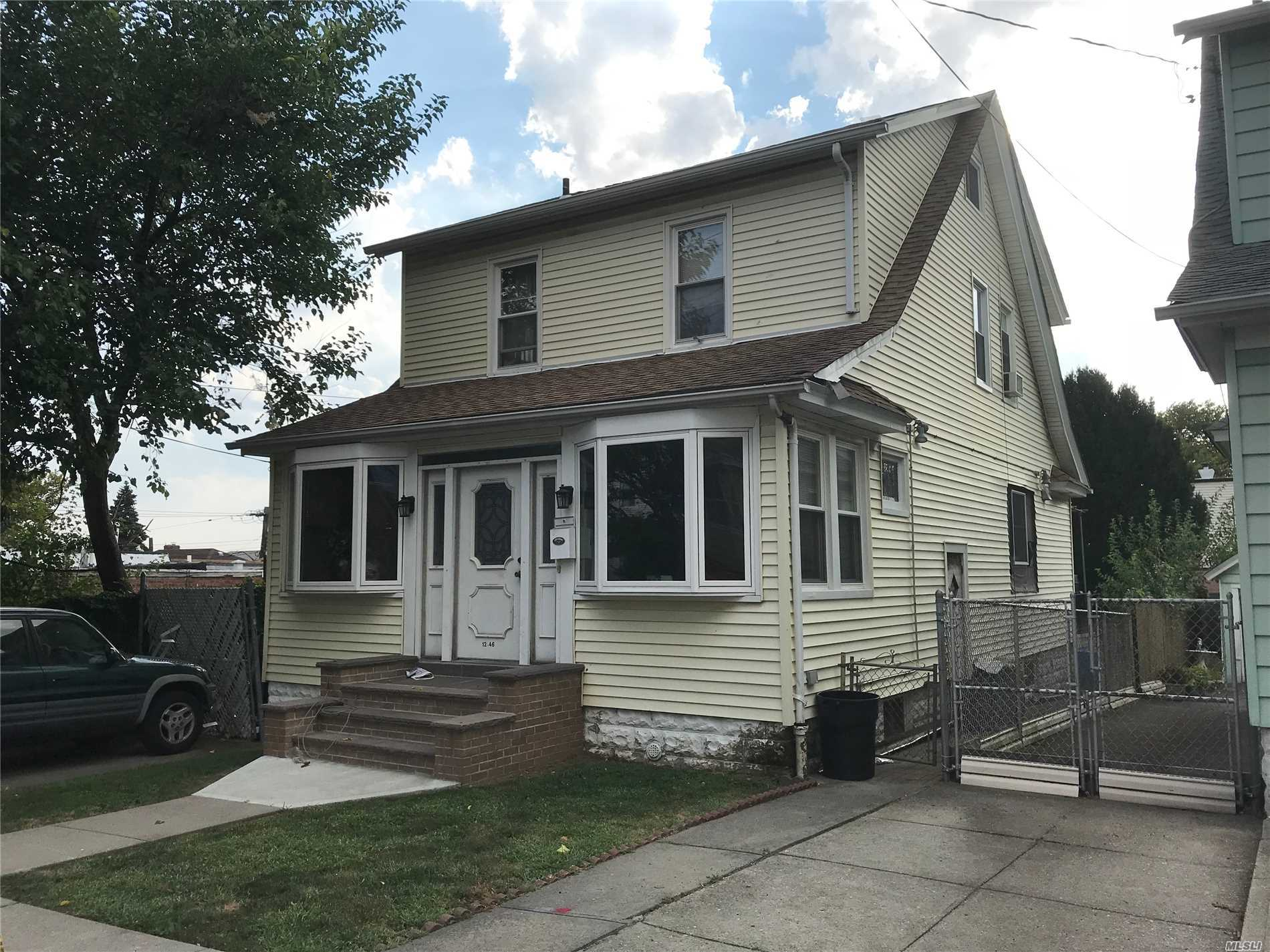 Detached Colonial W. Den, Large Living Room, Formal Dining Room, Updated Top Of Line Material With Granite Counter Top, 3 Decent Size Bedrooms, Pull Down Attic, Full Finished Basement With Sep. Ent. Det Gar With Parking, Ez To All