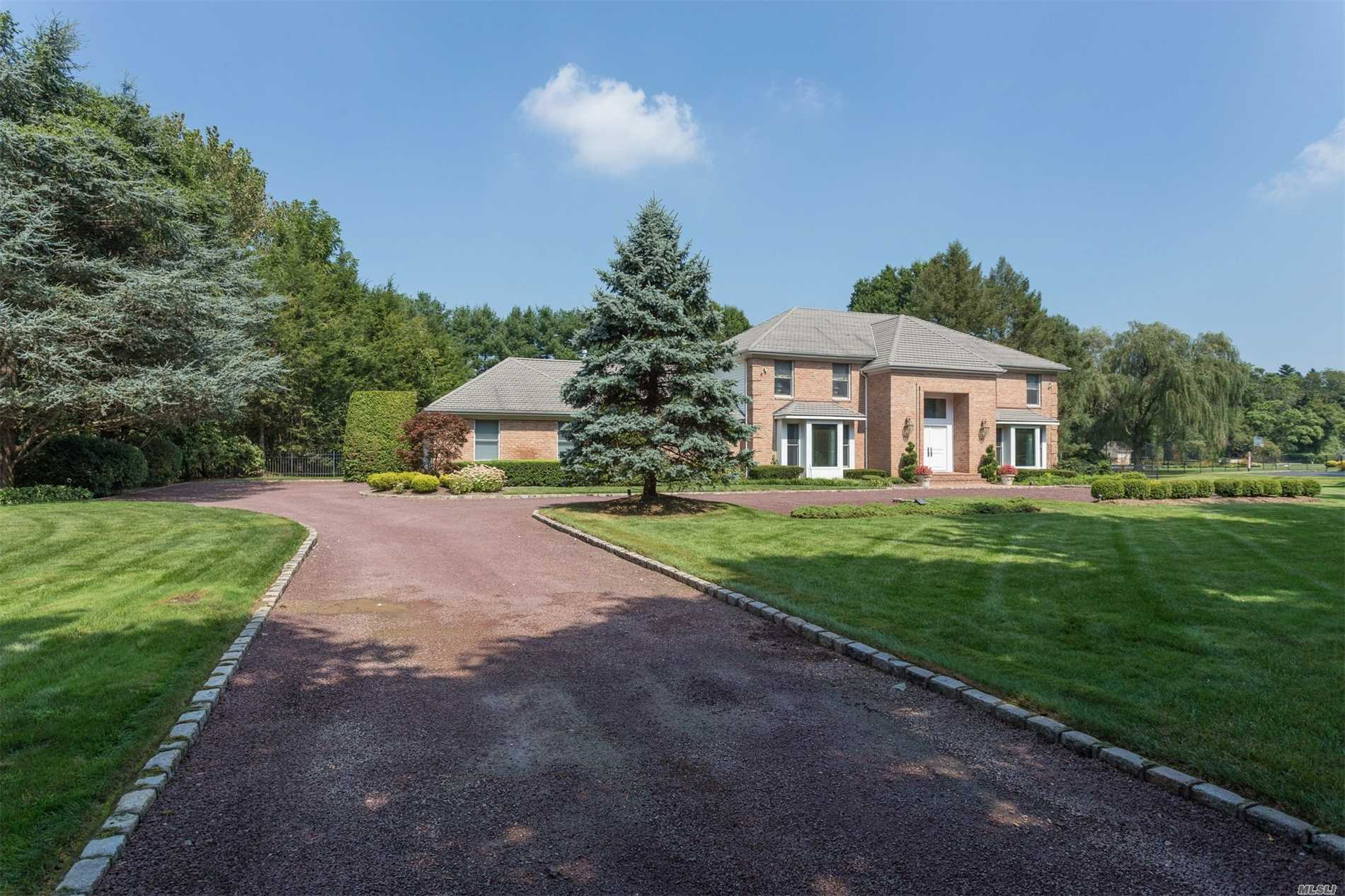 Gracious & Pristine Colonial Set On Lush, Flat 2 Acres In Country Club/Botanical Setting In Prestigious Old Brookville. Soaring 2 Story Entry Opens To Unobstructed Views Of Heated Gunite 20X44 Pool, Trex Deck, Patio And Manicured Grounds. Stately Formal Dining Room, Butler's Pantry, Eik, Formal Living Room, Den With Custom Onyx Fpl, 5 Bedrooms, 3.5 Baths, Four Season Sun Room, Low Taxes. Hoa Yearly Fee $1, 000 For Private Road