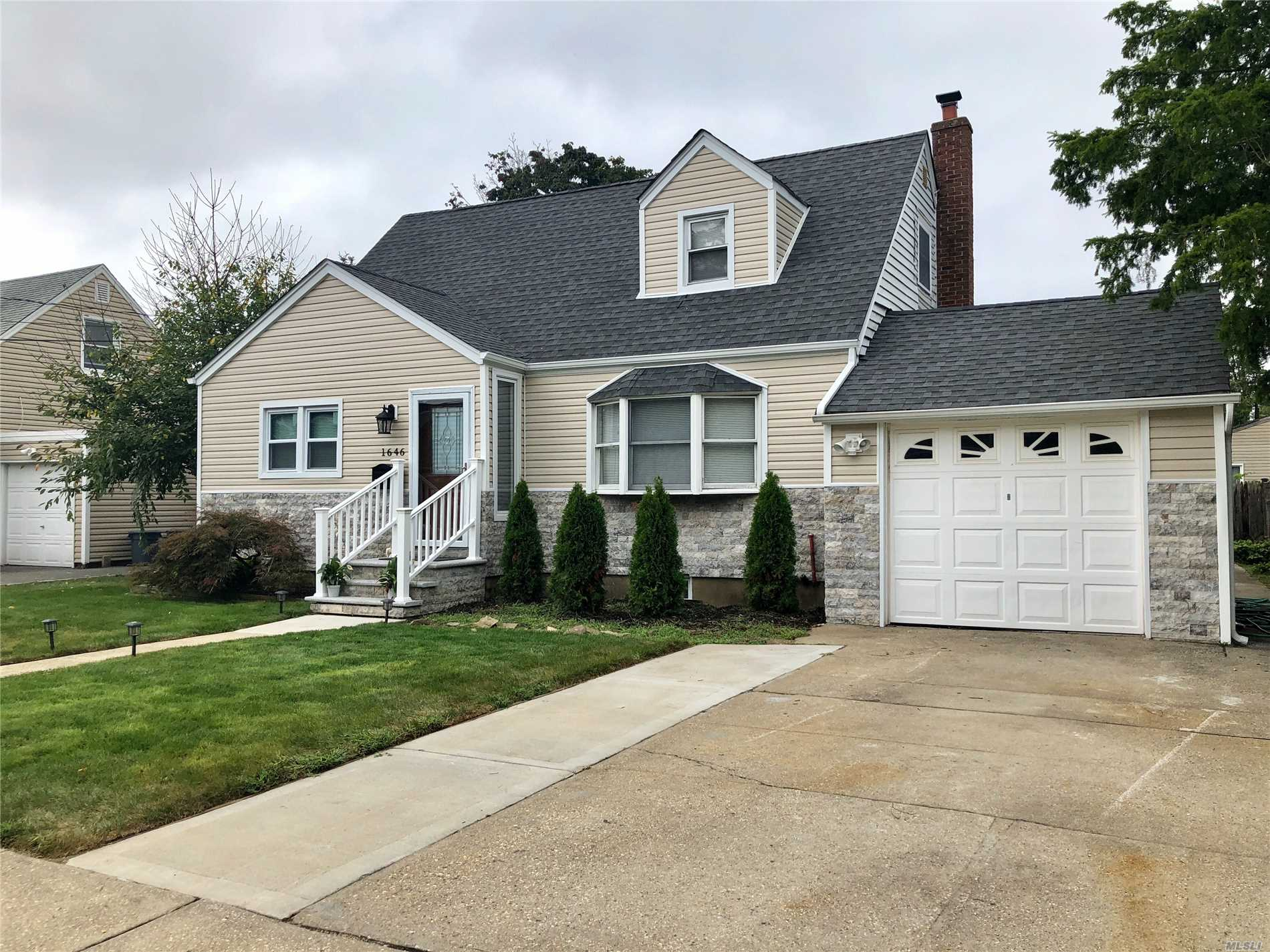 Fully Remodeled Cape Features 4 Bedrooms, Master Suite/Jacuzzi/Shower And Wic, 3 New Bths, New Large Eik, Full Finished Basement, Mint Extended Cape.