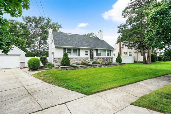 Move In Ready And Turn Key! This Home Is Completely Renovated. The First Floor Has A Large Master Bedroom Which Can Easily Be Converted To Two Bedrooms. Open Concept Kitchen, Dining Room, And Living Room. Renovated Bathrooms On The First Floor And Second Floor. Full Finished Basement. Tastefully Redone Exterior And Well Manicured Over-Sized Yard. A Great Opportunity In An Excellent Location. Will Not Last!!