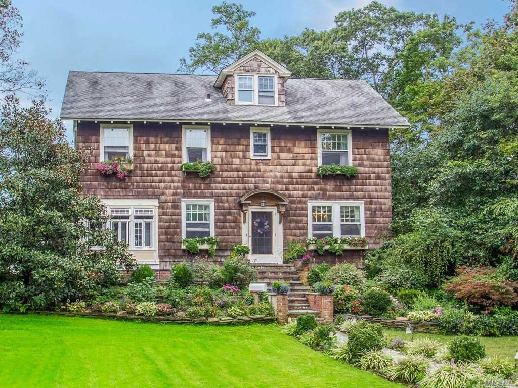 Village Ackerson Colonial On The West Side Of The Lake. Beautiful Cedar Exterior, Flr W/Fp, Fdr, Wood Flrs, Coffered 9' Ceilings, Moldings, New Windows, New Chefs Eik (Viking, Subzero, Bosch), 6 Bdrm 2.5 Bath, South Facing Sunroom. Third Floor 2 Bdrm 1 Bath Maids Quarters, Large Dry Basement. Gorgeous Landscaping, Charming Window Boxes, Large Garage W/Loft Space, Village Amenities Inc Docking, Parks, Beach, Tennis, Snow Removal And Code Enforcement.