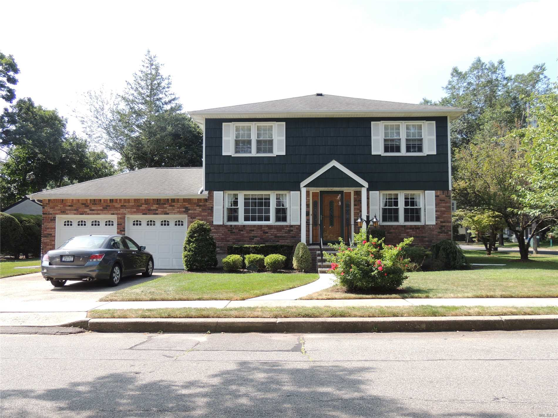 Get Out Your Samsonite Luggage And Start Packing...The Perfect Stately Mint 4 Bedroom..2.5 Bath Center Hall Brick Colonial..New Siding/Front Dr/Gas Heat/Hot Water Htr/New Baths..Custom Wainscotting & Crown Molding..Large Liv Rm..Gleaming Hdwd Flrs..Mastr Bedrm Suite W/New Bth W/Rainshower & Bodyjets..Brand New Marble Bth..Central Vac..Large Bsmt W/Sep Ose..Gas Generator A Bonus..Prof Land W/Igs..Successful Grievance Will Take Effect 10/18..31.64% Reduction..Approx Savings $4500.00..Close To Park