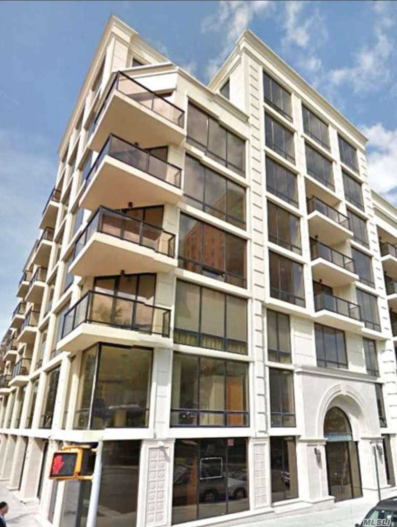Luxury Doorman Building In Rego Park. 1184 Sqft, Large Size Lr, Dr, 2 Br W/Jacuzzi Bath. Total 2.5 Bath. Private Balcony, Custom Cherry Wood Cabinetry, Granite Countertops, Bosch Washer & Dryer, High End Stainless Steel Appliances. High Ceilings, Floor-To-Ceiling Windows, Central A/C! Lounge On Spacious Roof-Deck, Work Out In The Fitness Center, And Relax In The Steam Rm Or Sauna. M & R Trains Just 4 Blocks. 30 Min To Manhattan! Rego Park Center Only A Few Blocks. Walk To Flushing Meadow Park!
