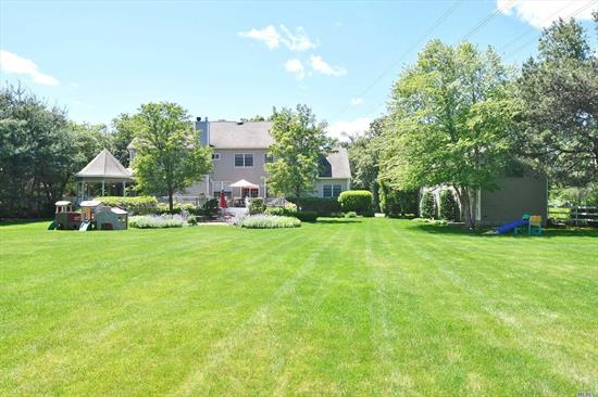 Double Story Entry Foyer, L/R, D/R, Den With Fireplace, Custom Kitchen W/Heated Floor Office Or 5th Bedroom/Full Bath. Horses Property. Wraparound Custom Deck. Carriage House. Flat Park Like Property. A Beautiful Sunlit House... Must See!