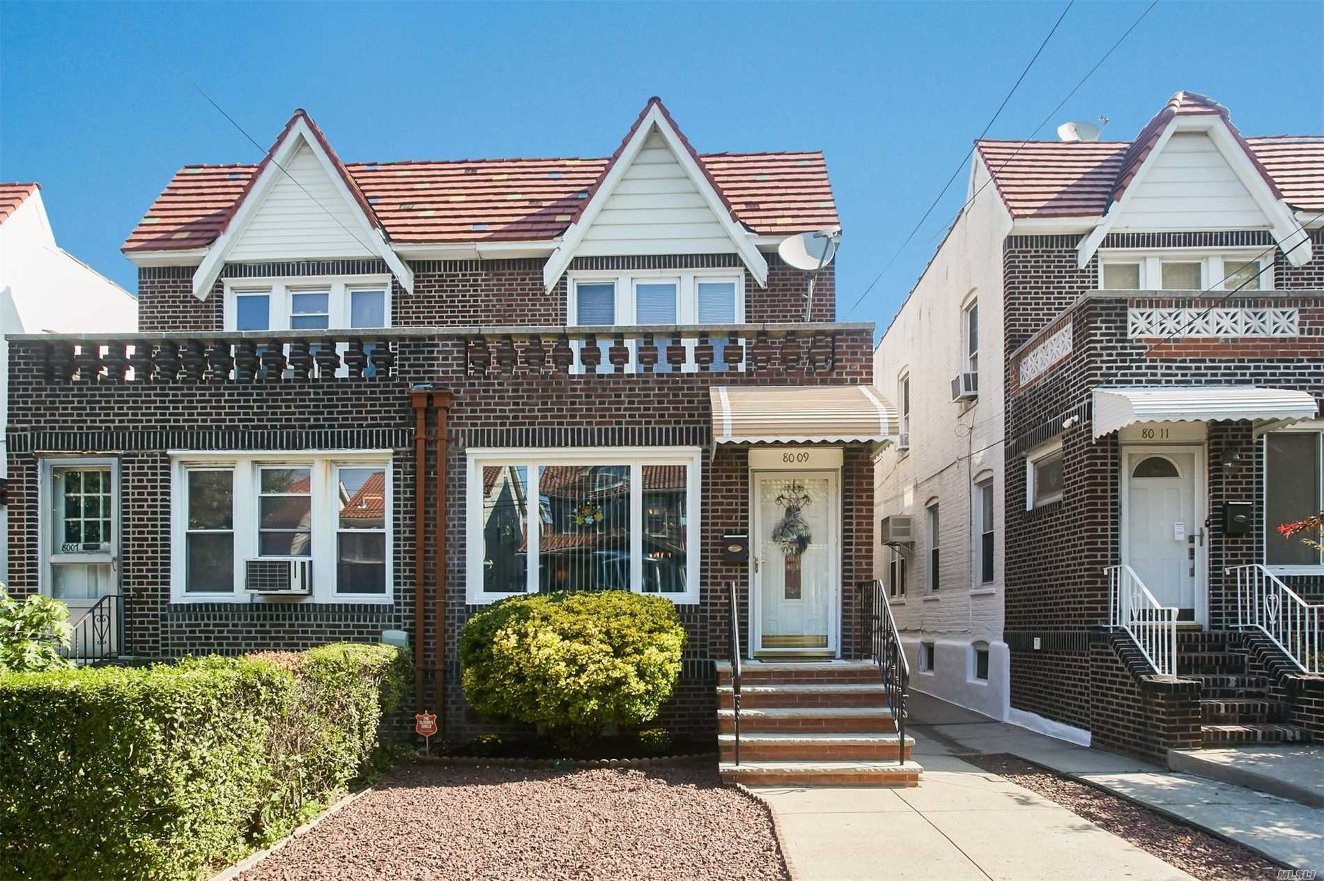 Beautiful Semi-Detatched 3 Bedroom Brick Home That Features A Kitchen With Granite Counters And Stainless Steel Appliances, Beautiful Hardwood Floors 2 Modern Bathrooms And A Finished Basement With Wet Bar, Plus This Home Has Central Air , 2 Blocks From Express Bus To Manhattan And Zoned For Ps113