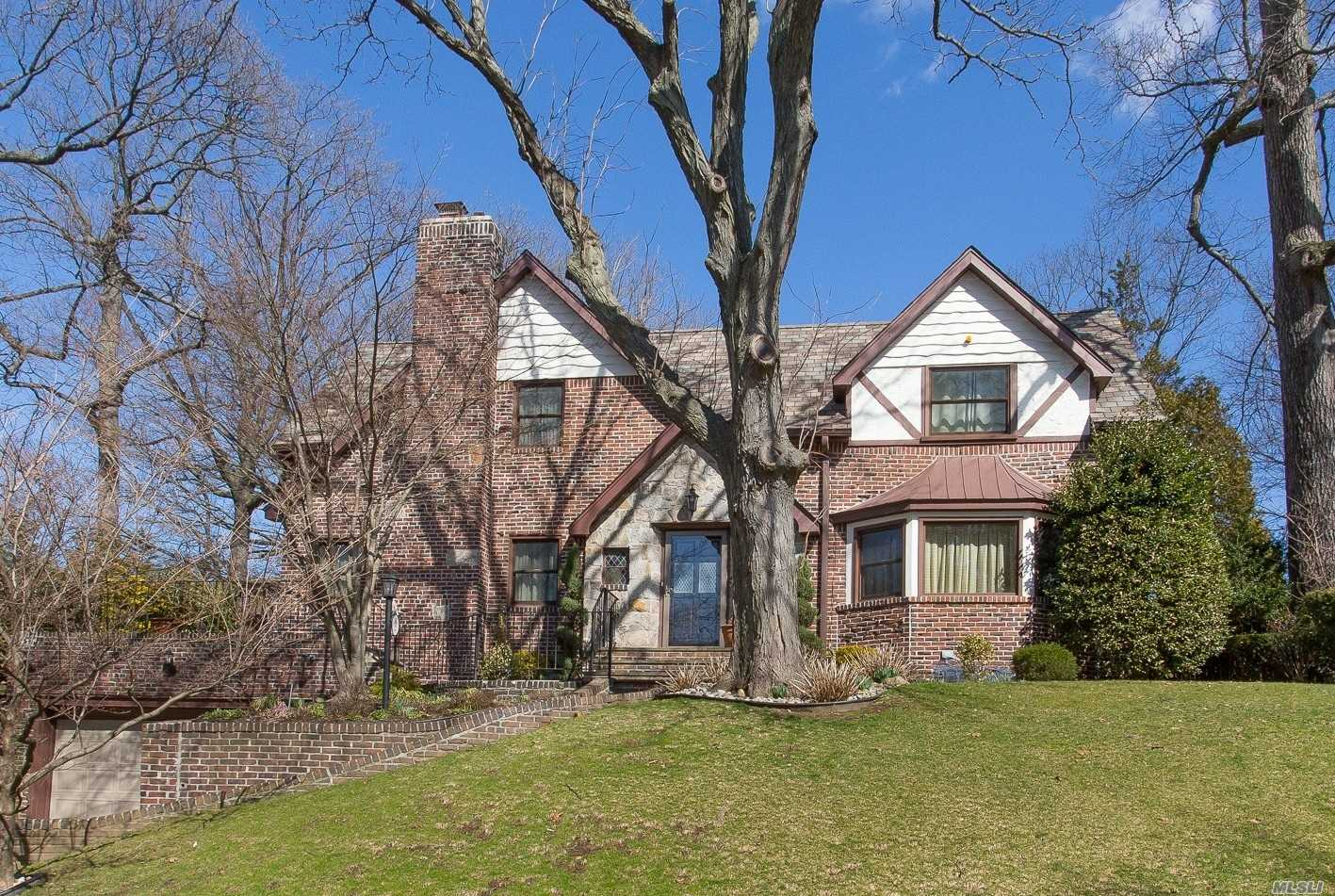 This Sprawling And Unique Tudor Center Hall Colonial Is Unlike Any Other Home In Jamaica Estates! Set On Almost One-Third Of An Acre, This Stately And Inviting Home Boasts An Amazing Layout And Never Ending Architectural Surprises. Just Off The First Floor Sitting Room, The Granite Tile Patio Offers A Graceful Location For Entertaining Guests. Personal Touches Give This Home The Perfect Balance Of Elegance And Warmth, Ideal For Any Family To Move Right In.