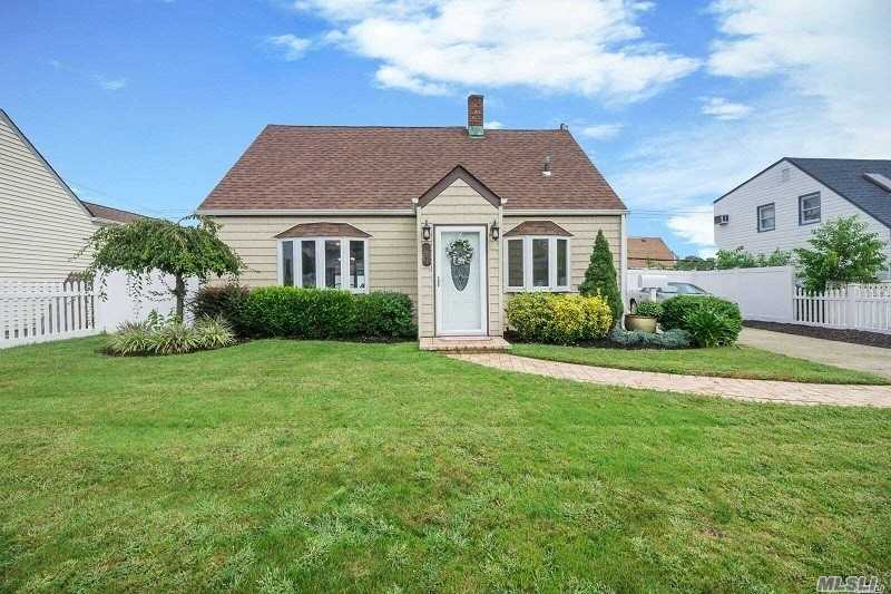 Perfect Dollhouse! Mint 3 Bedroom Cape Offers Updated Kitchen, Bath, Roof, Windows, Boiler- 6 Years Young, Wood Deck And Detached Garage. Nothing To Do But Move In!! Check Out The Low Taxes!