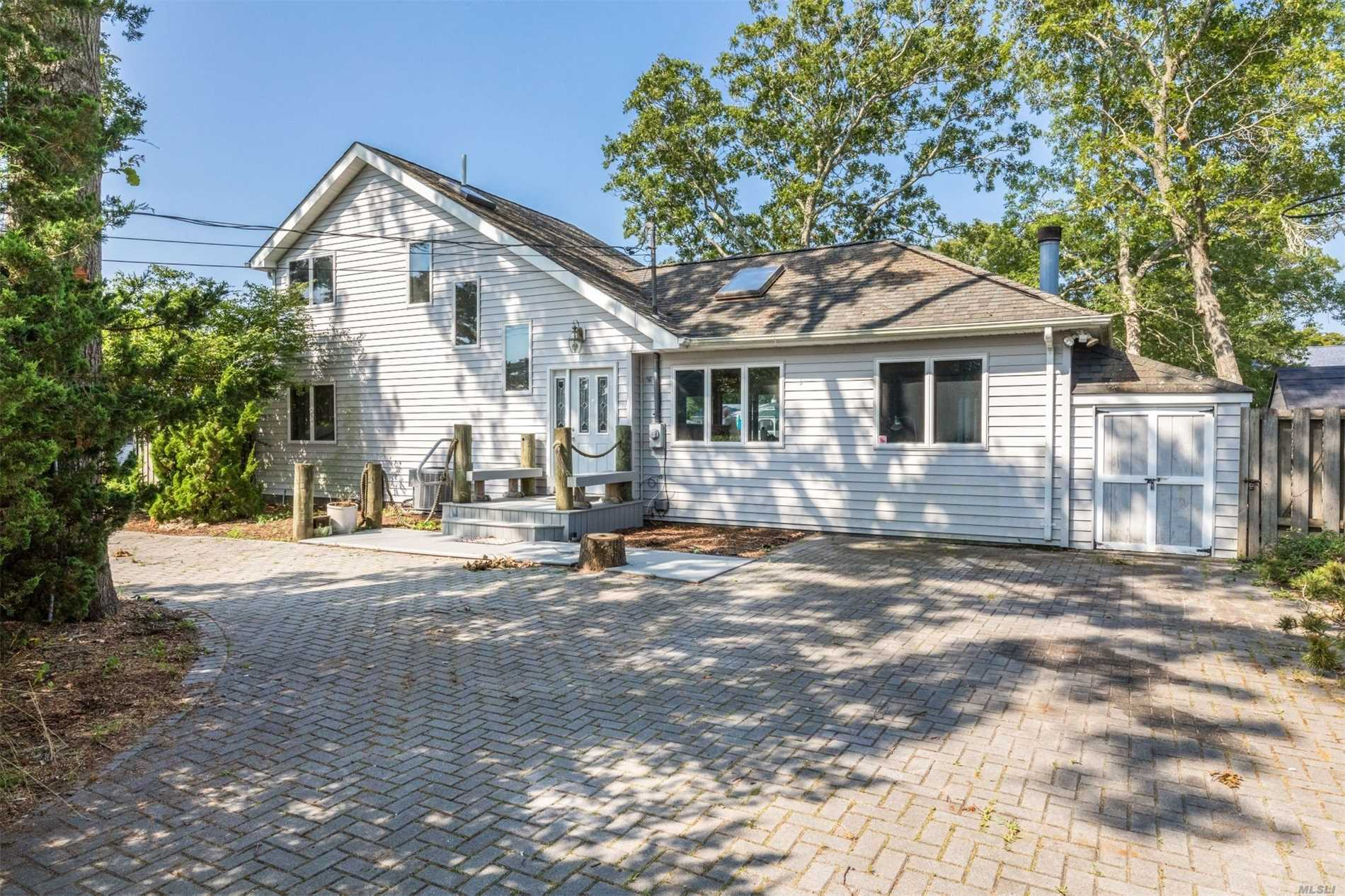Close To Restaurants, Shopping, Private Beaches, And Wine Country, This 4-Br, 3-Ba Contemporary, Fully Furnished, Is Sited On A Bulkheaded Canal. Perfect For Boaters And Fishermen (Or Women). Has An Expansive Deck With A Hot Tub.