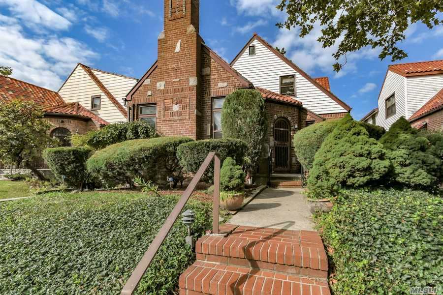 This Lovely Mediterranean Inspired Tudor Home Offers An Entry Foyer, A Living Room With Fireplace, A Formal Dining Room, Eat-In-Kitchen, 5 Bedrooms, 2 Baths, An Attic, Finished Basement, And Garage,