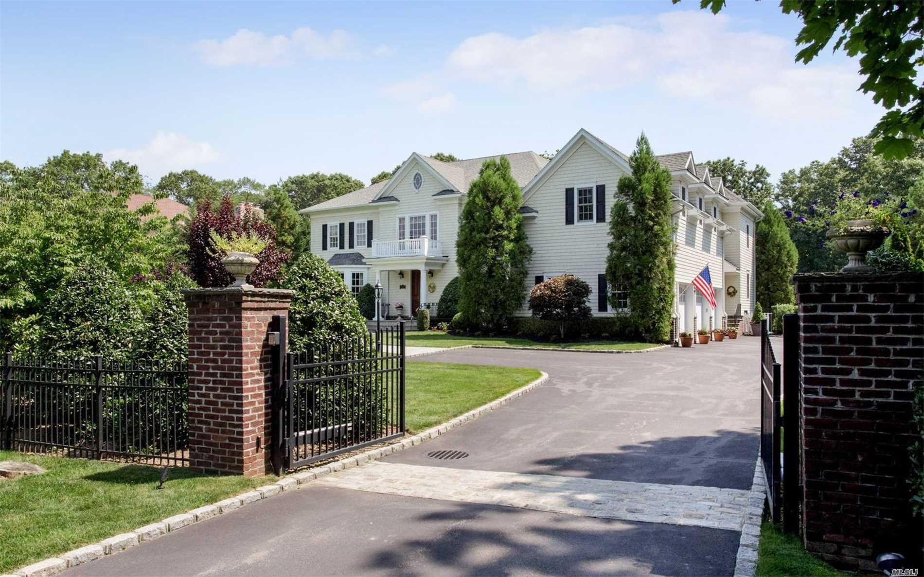 Gracious Ch Colonial, Gated & Privately Set Back In No. Syosset. Built In 2007, 5200Sq', With 9' Ceilings. Lg Crown Moldings, Open Flr Plan, Hw Flrs. Walk-In Closets. Great Center Island Kitchen W/French Doors To Pool. Double Door Entry Master Suite W/Gas Fp. Traditional Flair. 4 Brs + Office/Maid's Rm + 2nd Flr Media Room. 1 Acre Landscaped Setting W/Salt Water Heated Pool. Private & Wonderful!