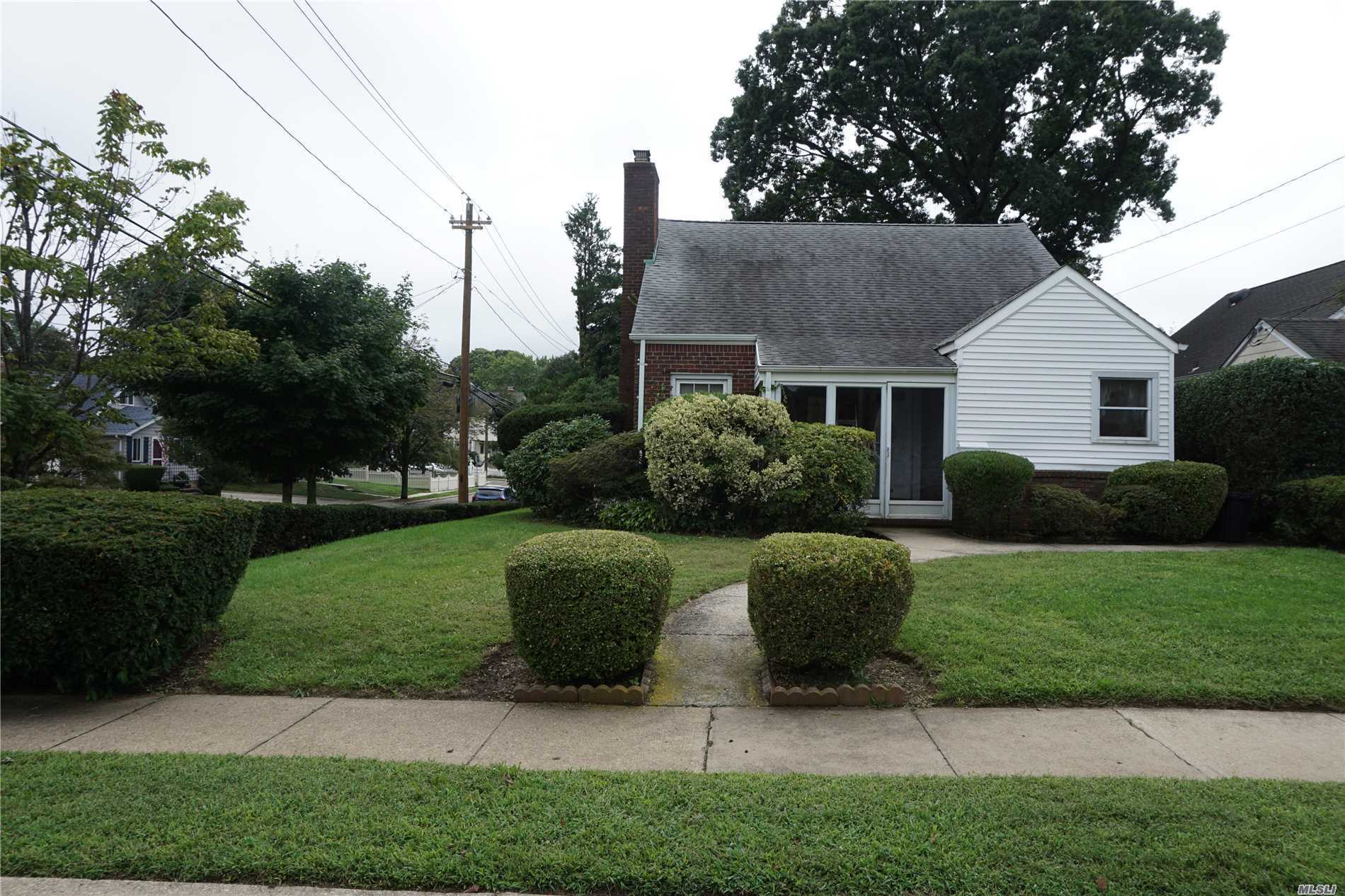 Renovate This Home Into Your Dream Home!Great Location/Quiet Residential Area, 4 Br, 1Fbth Cape, Lovely Entry Foyer, Lr W/Wood Burn. Frplc, Kitchen W/Gas Cooking, Fdr, Wood Flrs Thruout!, Mbr, Br, Fbth-2nd Fl.-Sitting Area, Br, Br W/Ose To Sun Porch, Wood Flrs, Built-In Shelves Open Up To Eaves For Storage (Cubbies), Full Bsmt Part Fin., Beautiful&Lrg Yard For Entertaining So Much Potential To Make This Your Forever Home! Award Winning Plaza Elem. School, Close To Lirr & Shopping.Home Won't Last!