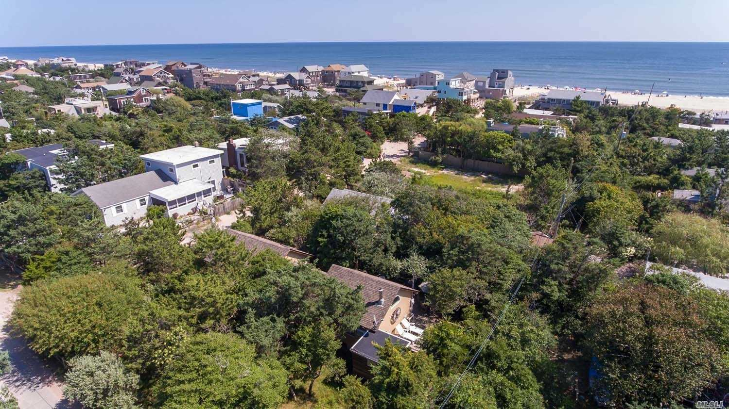 Fabulous Proximity To The Beach! Move In And Live The Life. You Can Build Up And Enjoy The Beautiful View Of The Bay And Ocean! 75 X 100 Property With Room To Put In A Pool Oasis!