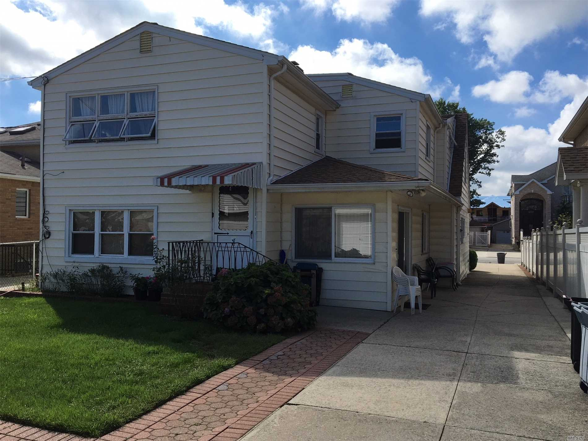 Rare Investment Opportunity In The Heart Of Whitestone!! Legal Two Family On Extra Deep Lot!!, 5 Bedrooms (Could Be 6 Bedrooms), 3 Bath With Two 2 Car Garages!! Long Driveway, Very Conveniently Located Near Shopping, Buses, Parkways, La Guardia, Whitestone Bridge.