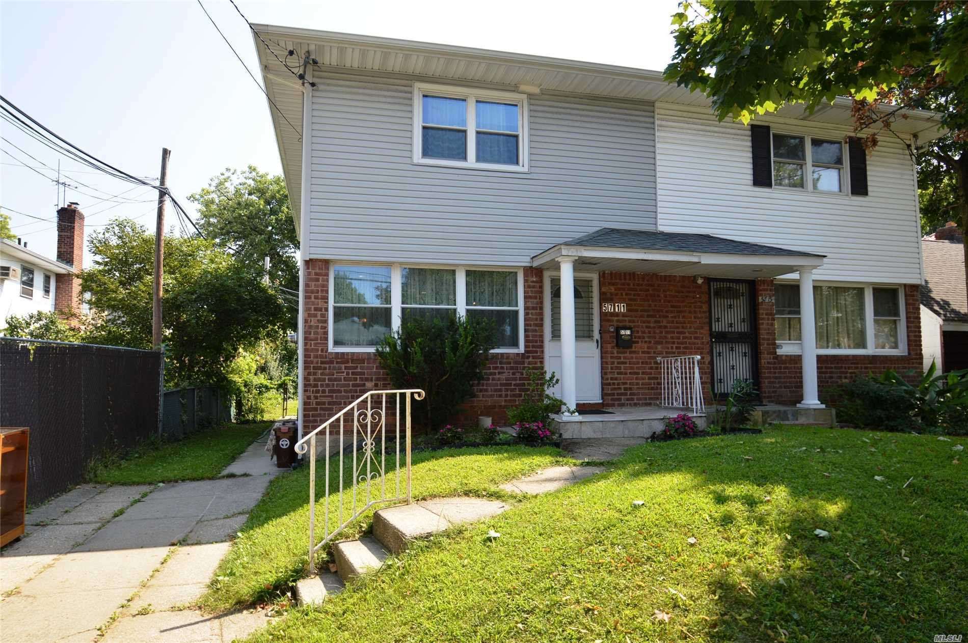 Absolutely Beautiful Sun Filled 3 Bedroom, 1.5 Bath Updated Colonial With Hardwood Floors Throughout. Near Express Bus To City, Lirr, Major Highways & Shopping. School District #26, Ps 221 & Ms 67. Spacious Living Rm, Formal Dining Rm, Gorgeous Eat-In-Kitchen With Granite Counter Tops & Top Of The Line Appliances. Powder Rm On First Floor. 3 Over Sized Bedrooms And Full Marble Bathroom On Second Floor. Full Finished Basement With Large Rm, Laundry Rm & Bar. Attic. Lovely Backyard.