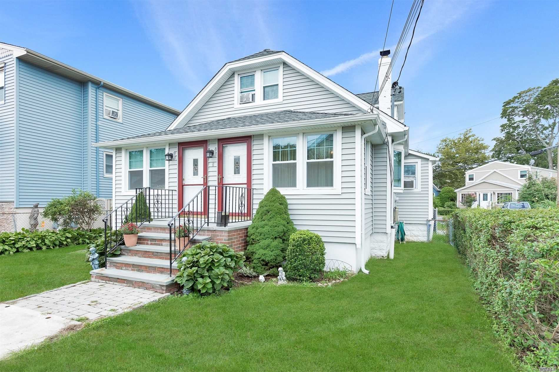 Great Investment! Legal 2-Family With New Roof, Siding, Windows, 2-Car Garage And Oversized Fenced Yard With Expansive Deck. Apt. 1 Is 1Br/1Bath All On One Floor. Apt. 2 Has 2Br/1.5 Baths. Two Decks, Gas Heating And Cooking. Stone's Throw To Beaches And Great Restaurants. Lvcsd Award Winning Schools.