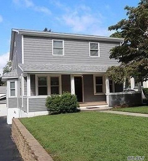 Spacious Updated Colonial In The Heart Of Oyster Bay, 5 Br W/ Vaulted Ceiling Master Suite, 3 Bath, 4 Car Garage,  Porch, Wood Floors, Large Ground Level Basement, New Front And Rear Dormers, Hvac, And Eik W/ Granite Counters , Island, Gas Stove, Ss Appliances And Double French Doors To Rear Deck. Second Floor Laundry, Weathershield Roof, Siding And Gutters, Save $$$ On Electric With Solar Panels Hidden In Rear, Plenty Of Storage, Low Taxes Close To All.