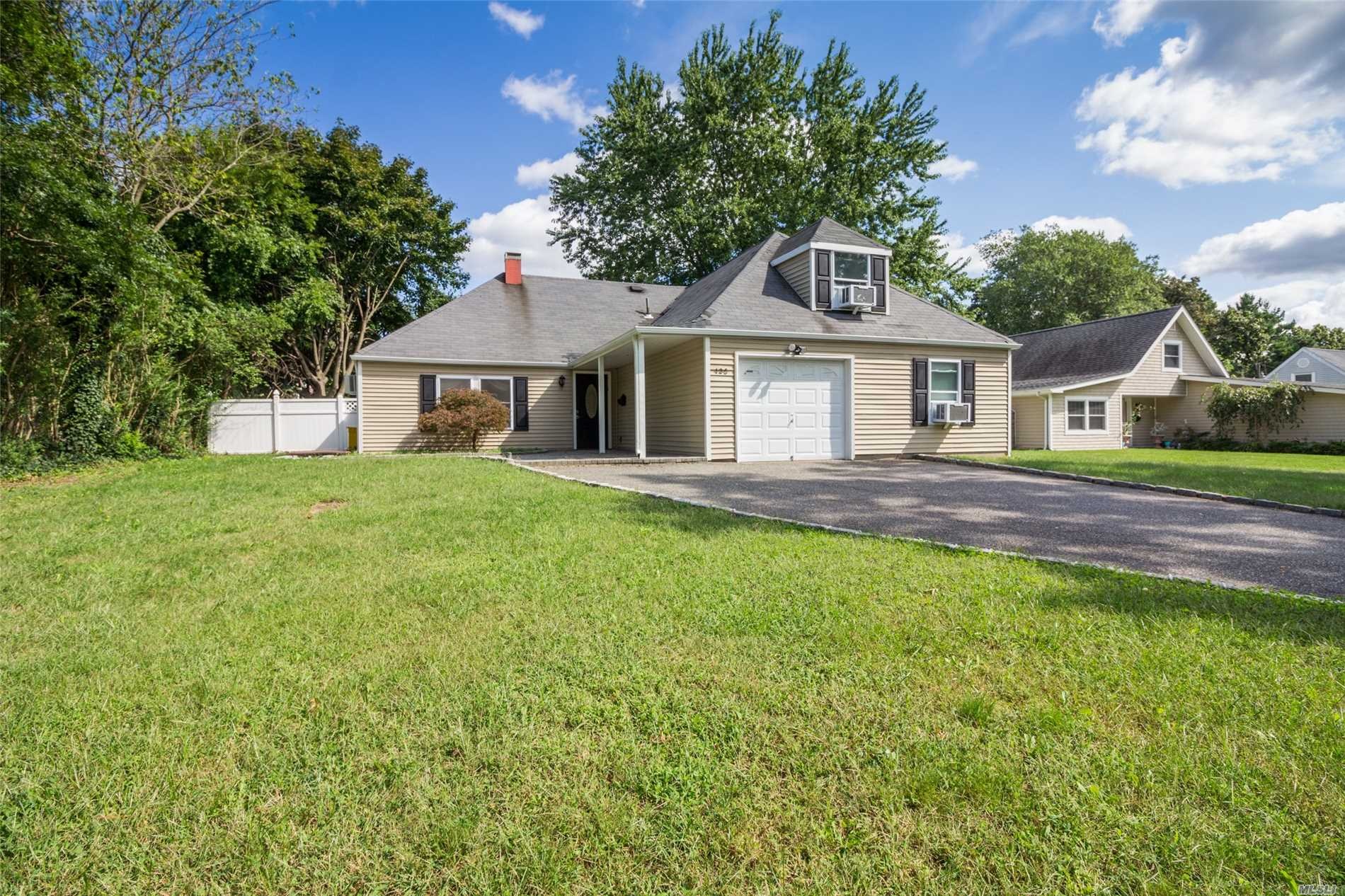 Spacious Open Floor Plan. All Updated: Kitchen With Granite Counter-Tops, Stainless Steel Appliances, All New Laminated Wood Floors Throughout, 5 Bedrooms, 3 Baths, Large Fenced In Yard, House Is Much Larger Than It Appears From The Street. Don't Miss This One !!