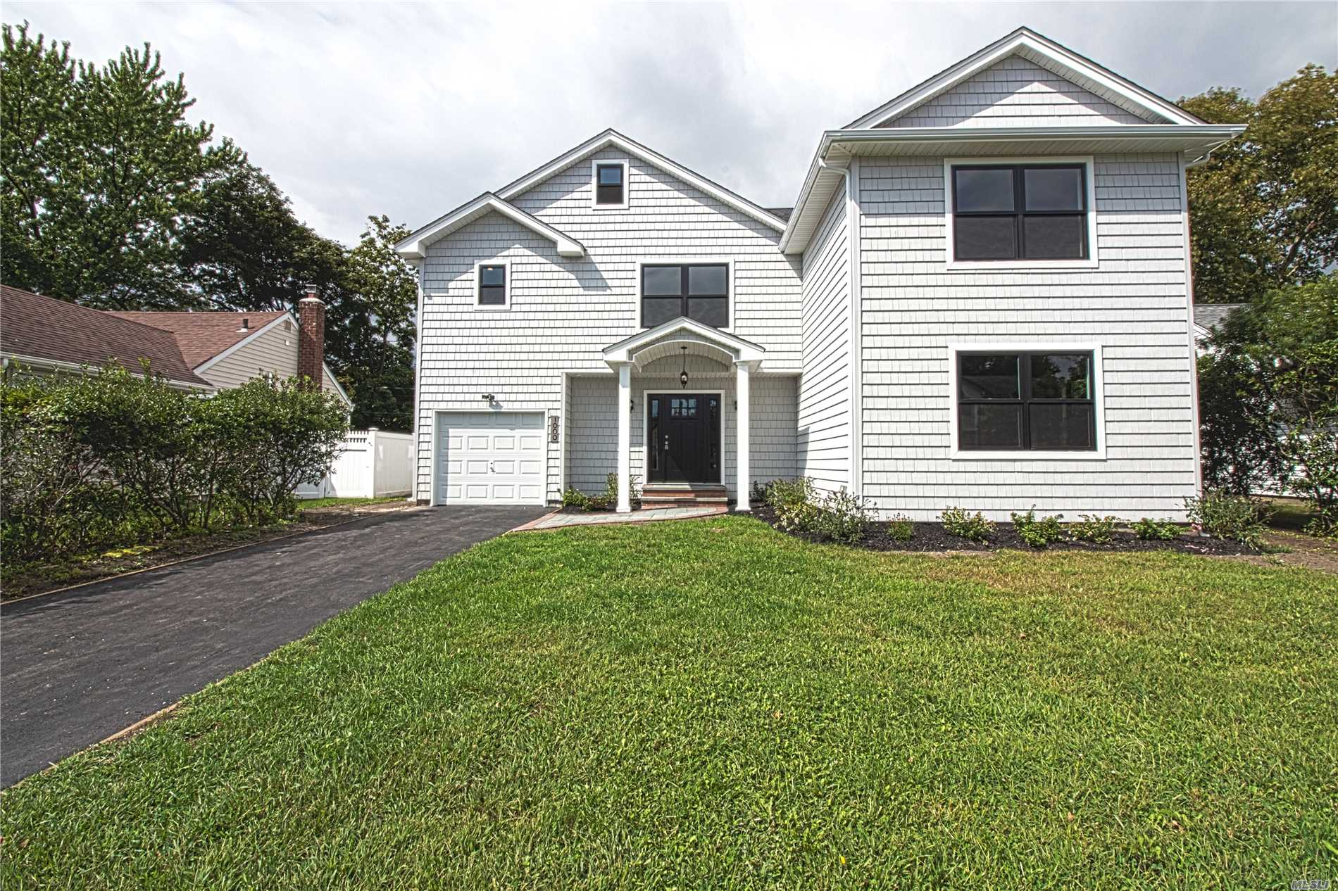 Amazing 4 Bedroom, 3 Bathroom Custom Colonial With Open Floor Plan, Hardwood Floors, Black Windows, Huge White Kitchen, Finished Basement And Much More.