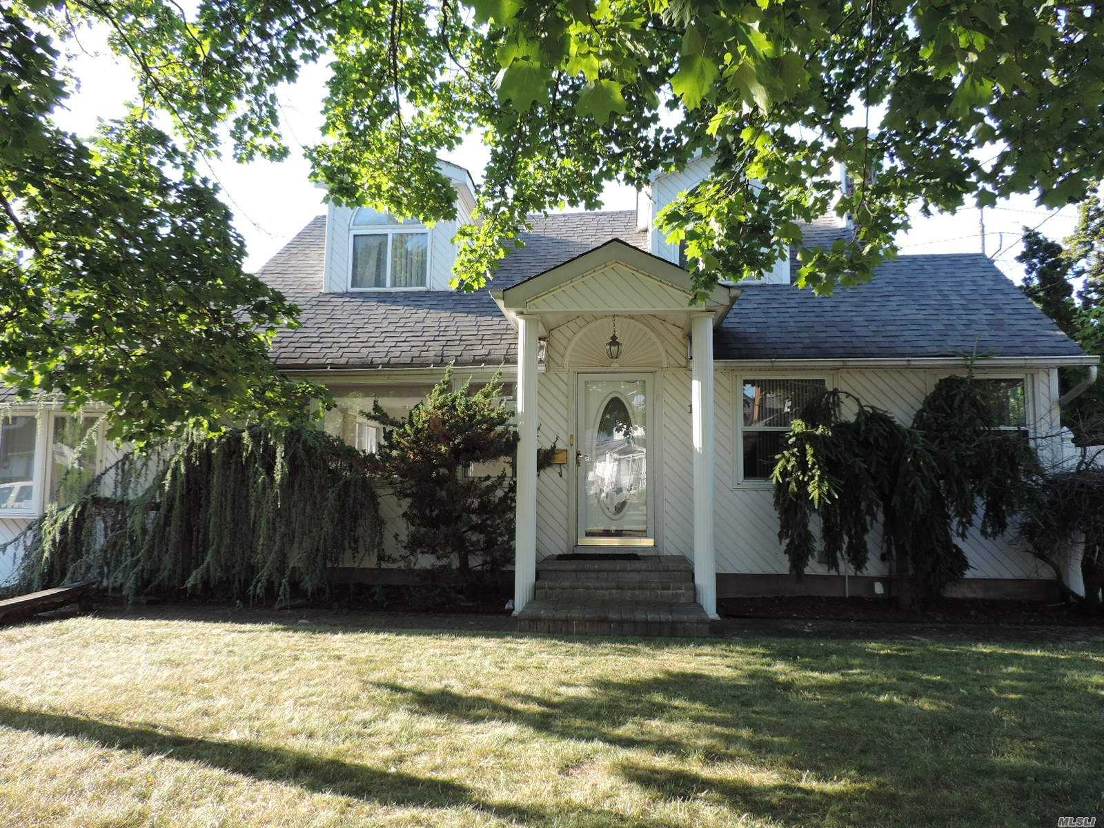 Excellent Opportunity To Add Some Tlc To This Expended Cape That Already Has High Ceilings, An Open Floor Plan, And A Full Basement. Do Not Miss The Chance To Own Or Invest In East Northport!!