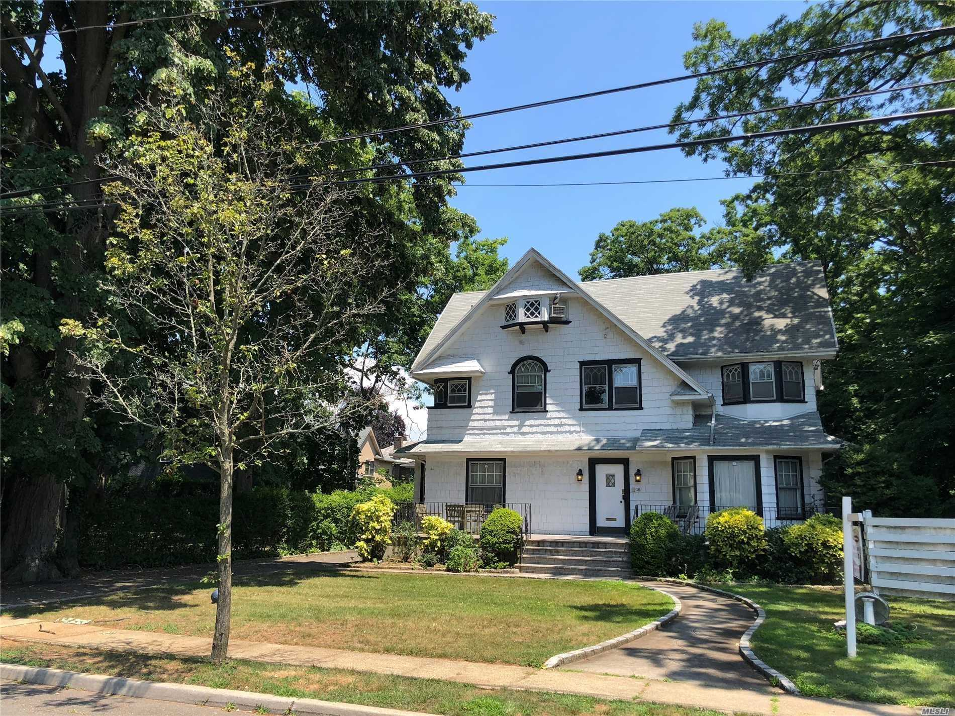 Center Hall Colonial In Sd#15. Features 7 Bedrooms, 3.5 Bath, Eat-In Kitchen With High-End Appliances, Living Room & Master Bedroom With Fireplace, Den With Built-Ins, Cac, Gas Heat, In-Ground Sprinklers, Alarm, Oversized Lot, Full Finished Basement & Attic. Close To All.