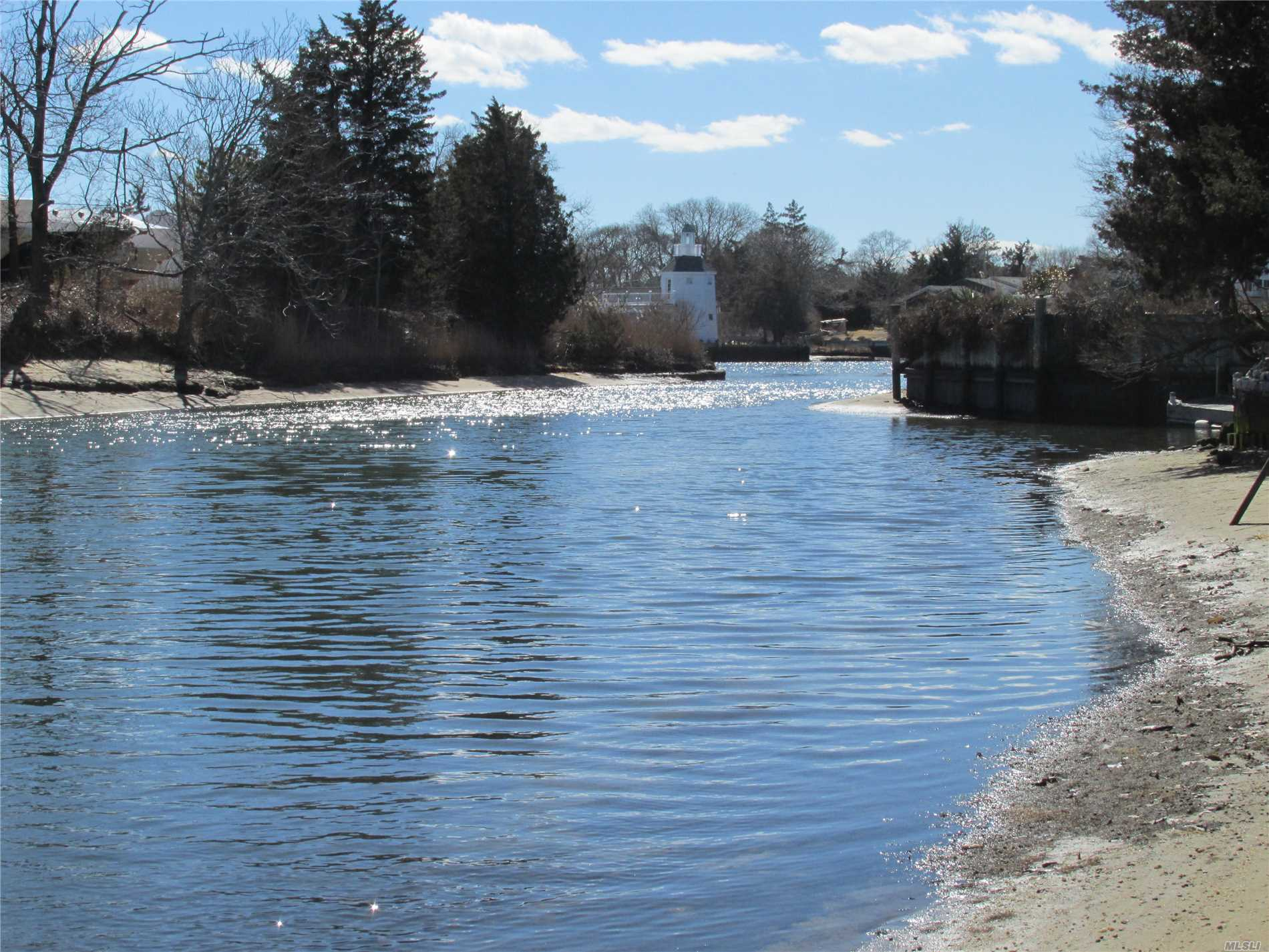 Sheltered Deep Waterfront On James Creek - .39 Acre Lot - 80' Frontage - Direct Access To Peconic Bay - Bay Beaches & Marina Nearby - Motivated Seller - Owner Financing May Be Available - Attached Survey From 2007 Has Site Plan For House/Dock - No Representation Is Being Made To The Feasibility Of Those Plans - Buyer Should Do Their Own Due Diligence Re Permits - Please Do Not Walk Property Without Listing Broker