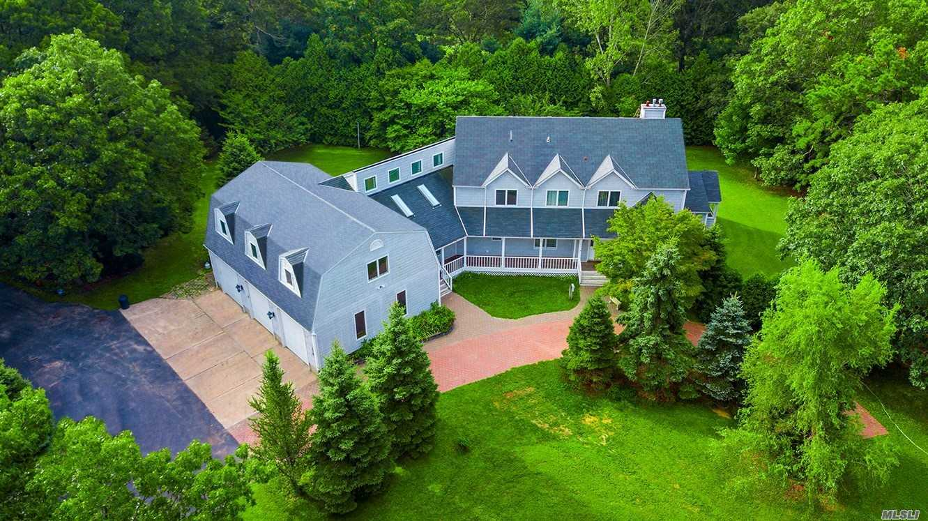 This Custom Built Victorian Farmhouse Is Privately Set Way Back, Surrounded By Woods & Is The Perfect Setup For Horse Lovers/Car Collectors/Business Owners W/ Its Oversized 3Car Garage W/10Ft Doors & Room For Office/Storage/Business Above. Featuring A Grand Entry Foyer W/Catwalk, Dual Staricase, Formal Din Rm, Eik W/Center Island, Dinette & Large Pantry, Gas Fireplace, Hardwood Floors, Enclosed Side Porch W/Storage Rm, Master Bdrm W/Full Bath, All Bdrms Have Walk In Closets, Covered Front Porch.