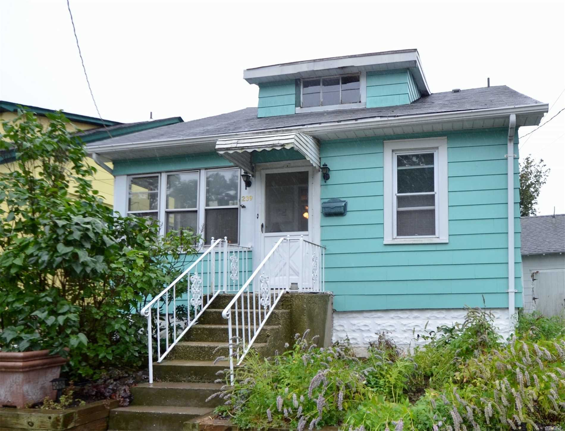 Great Village Location! Warm & Welcoming Cape! Enclosed Heated Front Porch, Lr, Eik, Master Bdrm, 1 Addl Bdrm, And Full Bath. 2nd Floor; Open Sitting Area And 2 Bdrms. Full Part Finished Basement W/Rec Rm, Laundry And Utilities. Across From Park! Award Winning North Shore Schools! A Must See!!