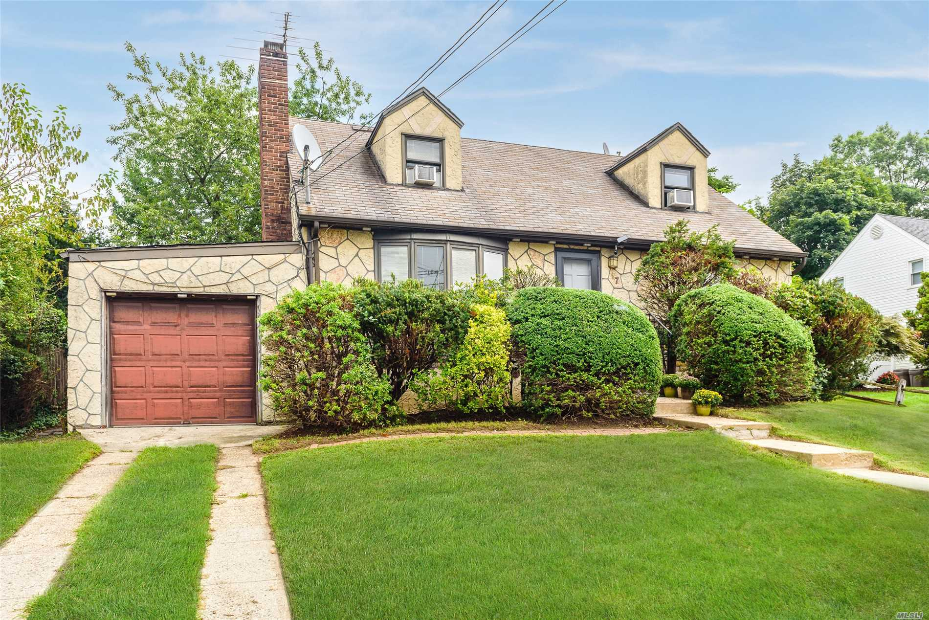 Lovely 4 Bedroom Cape In Herricks For $659, 000. Boasting A New Kitchen, Living Room W/ Fireplace, 1 Car Garage, Updated Heating System, Finished Basement & Much More. Situated Midblock On A Quiet Street!