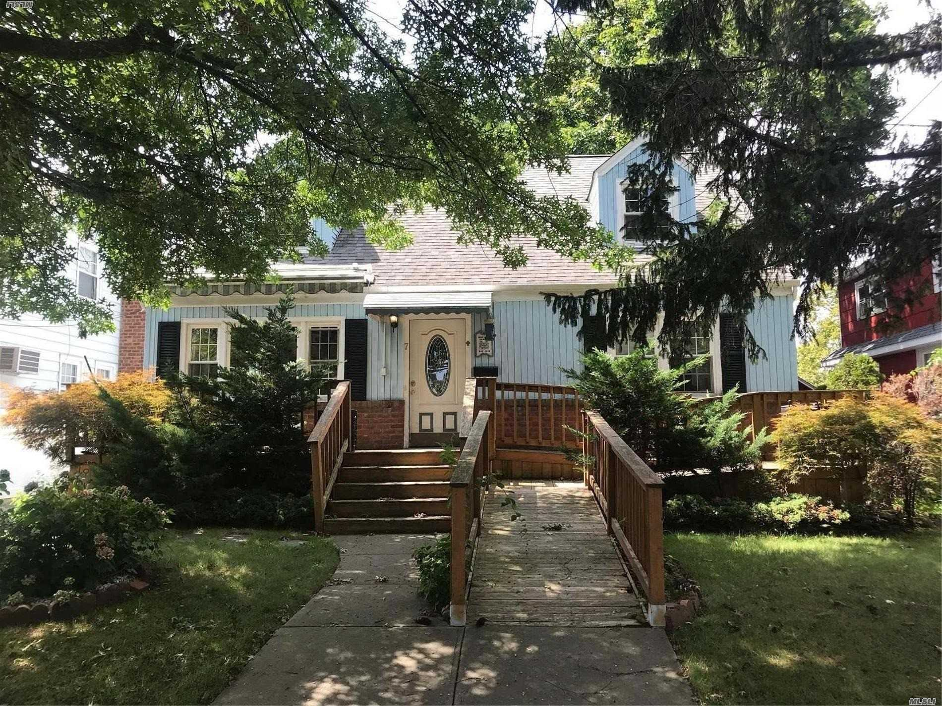 Great Expanded Cape Featuring 4 Bedrooms, 2 Full Baths, Hardwood Floors Throughout, Full Basement