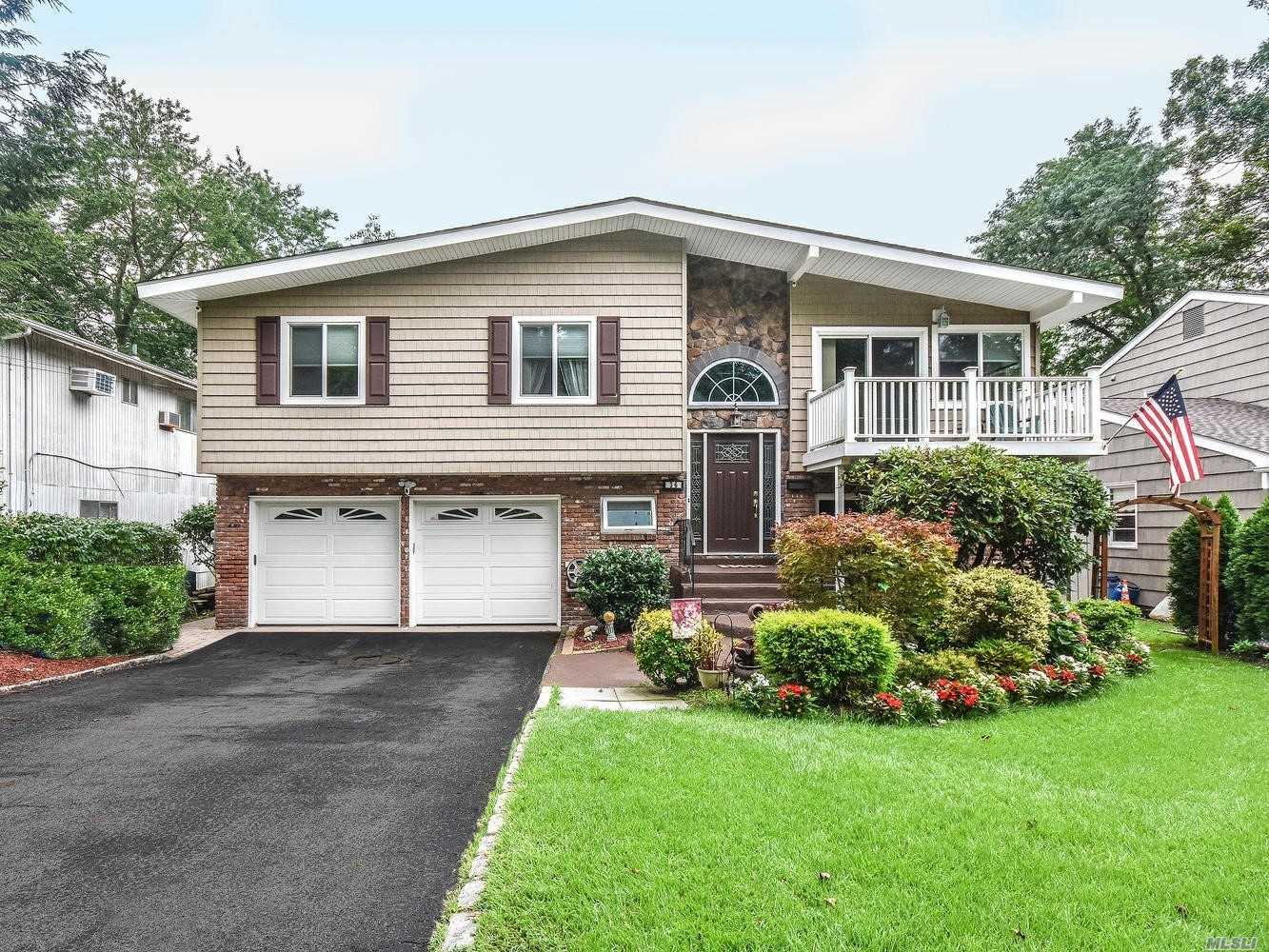 Mint Condition High Ranch All Updated On Quiet Dead End Street. 4 Bedrooms, 2.5 Updated Baths Renovated Kitchen, Dining Room W/Deck Living Room W/Deck, Den, Sunroom/Office, Laundry Room, 2 Car Heated Garage.