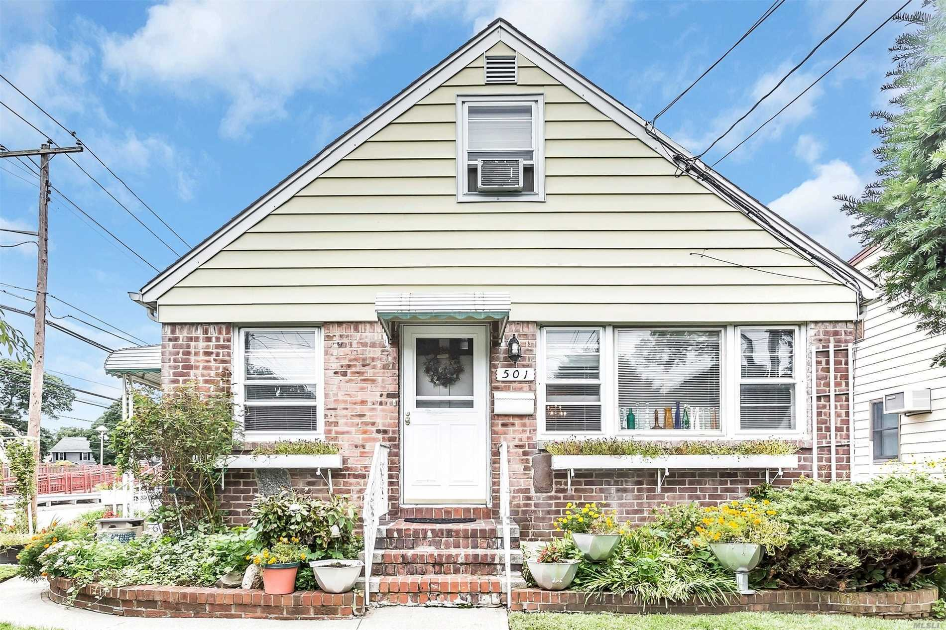 3 Bedroom, 2 Full Bath Inline Cape Set On 54 X 100 Property With 2 Car Garage And Finished Basement With Outside Entrance. Great Location For L.I.R.R Users.