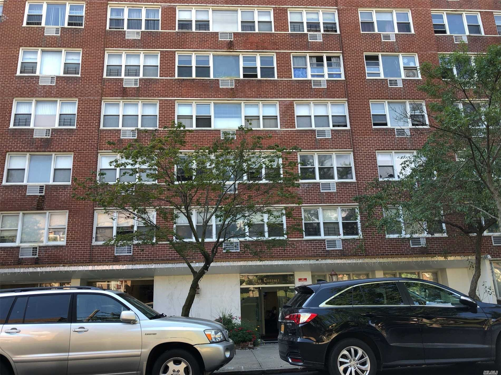 Large Sun Drenched 1 Bedroom With Windows In Every Room. Concerte Floors And Ceilings, Doorman Builing, Full Time Super, Laundry Room And Onsite Parking. Located On A Quiet Block, Close To Shops, Restaurants And All. Blocks Away To F Train.