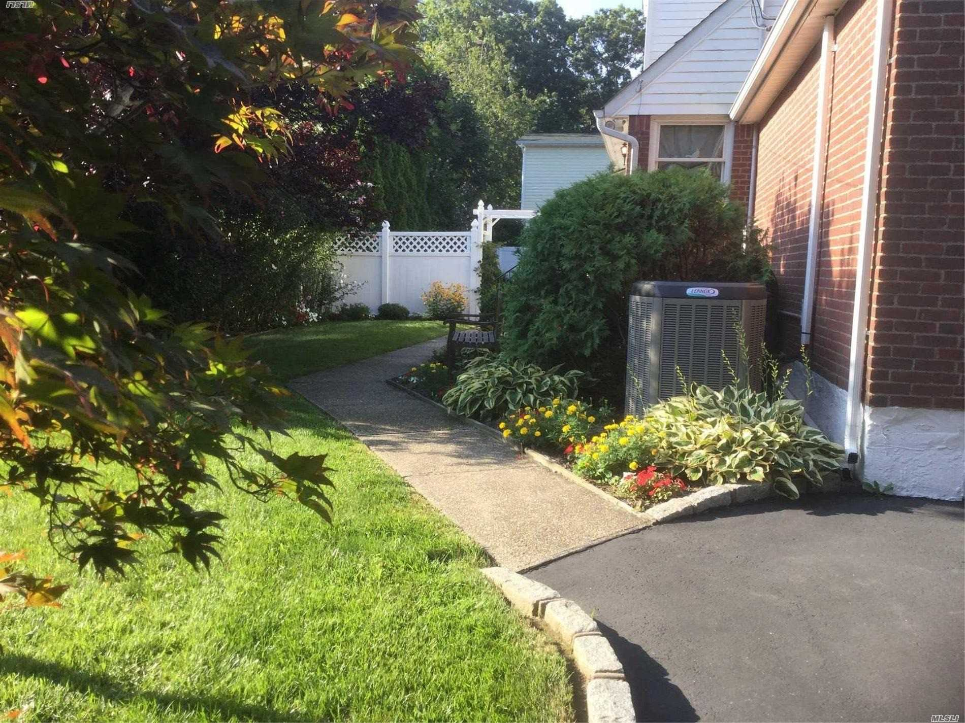 Immaculate 4 Bedroom Cape. Recently Renovated Kitchen/Granite Counters, Newly Renovated Baths, And Whole Interior Freshly Painted.All New Carpet On Second Floor And Refinished Wood Floors On Main Level. Lovely Gardens With A Waterfall Pond. Fenced Back Yard.