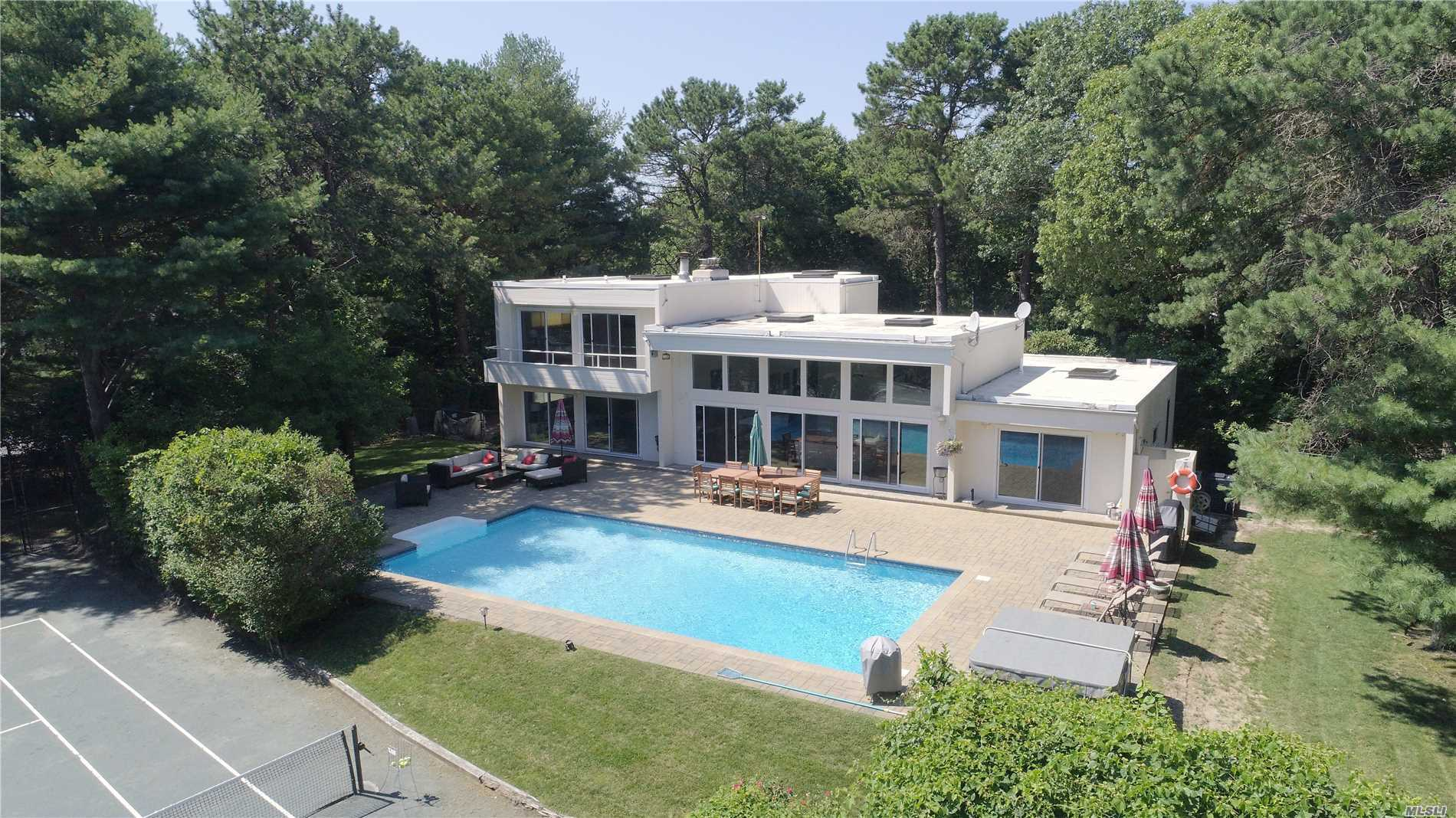 Updated & Well Appointed Five Bedroom, Three & Half Bath Contemporary Sited On One Acre With Har-Tru Tennis Court, Large In-Ground Swimming Pool & Access To All Southampton Town Ocean Beaches Makes For A Memorable Summer Rental Experience!