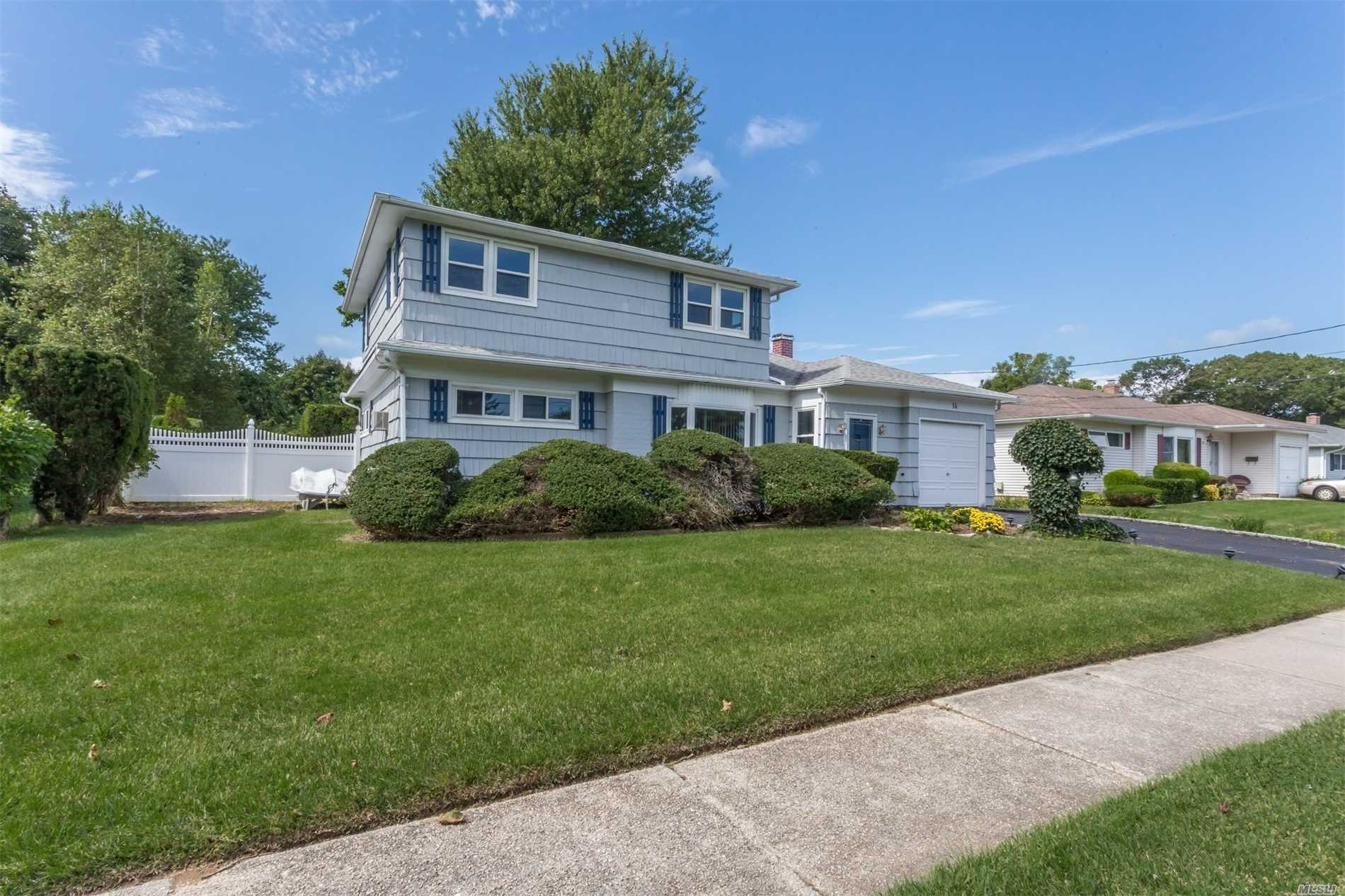 Expanded 5 Bedroom Colonial With Lots Of Potential In Sayville School District. The House Features A Bedroom And Bath On The 1st Floor With 4 Additional Bedrooms On The 2nd Floor With A Full Bath. Large Great Room With Vaulted Ceilings Off The Back Of The House With Sliders The Lead To The Park-Like Fully Fenced In Back Yard. Full Basement And Attached 1 Car Garage. New Roof (2011) With 30 Year Shingles. Great Neighborhood And Steps Away From The Golf Course.