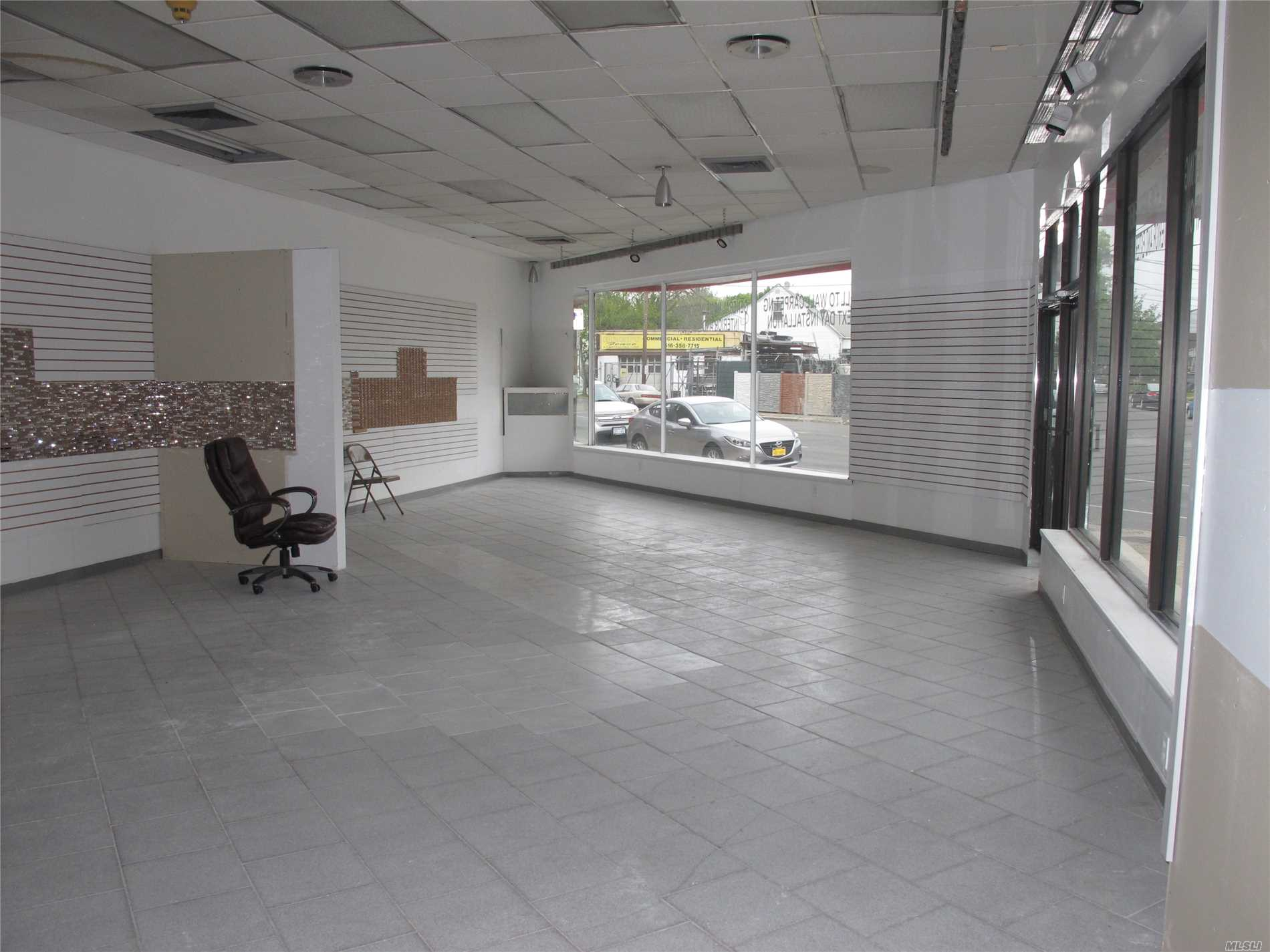 Corner Store For Showroom/Office Space. Bathroom, Bright Open Layout , High Ceilings, Big Windows , Located On Main St.