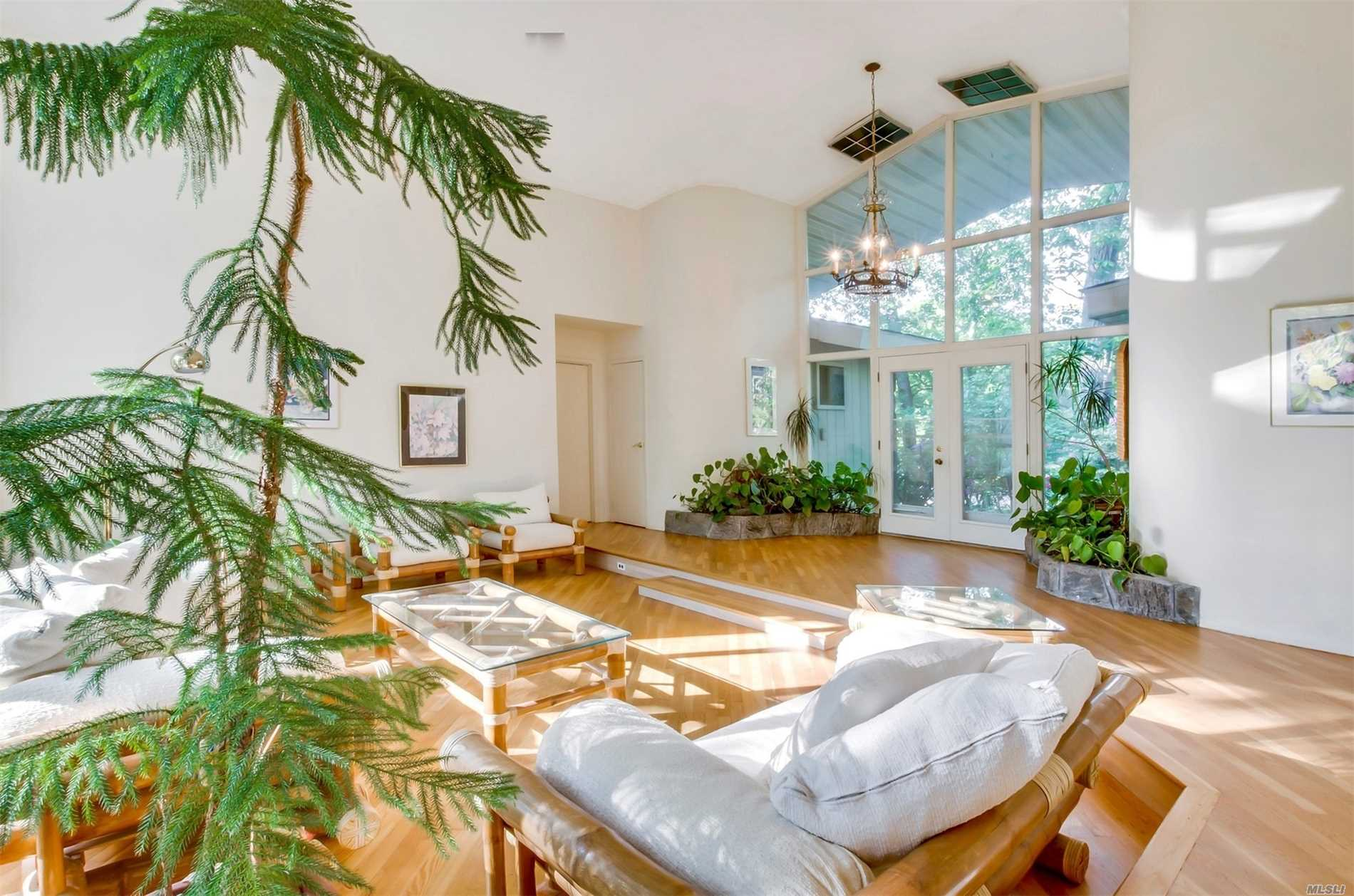 Natural Light Is Amazing. Expansive Ranch Nestled Into A Private Belle Terre Parcel With Mature Trees And Most Peaceful Setting But Also Within A Neighborhood. Oversized Rooms, Floor To Ceiling Windows, Ample Closets And Open Flow. Living Like You Are A Part Of Nature With Bright And Airy Sunroom. Updated Gas Heating System, Windows And New Roof. All Belle Terre Amenities.