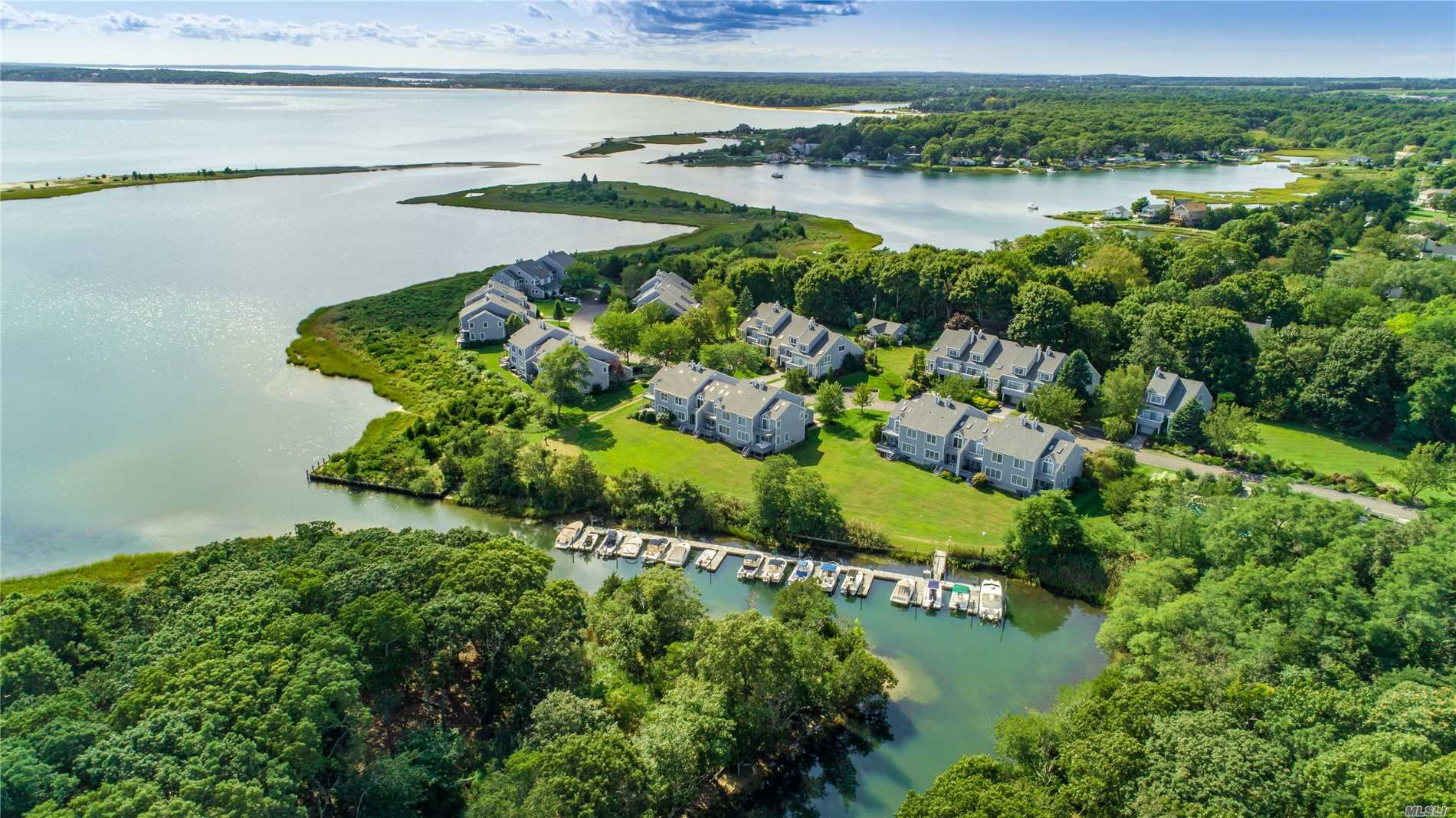 Enjoy Creek And Bay Views From This End Unit Waterfront Condo In The Cove At Southold. Master Bedroom With Waterside Deck, Two Additional Guest Bedrooms, One With Waterviews, Spacious Kitchen And Living Room With Brick Fireplace, Oak Flooring Throughout, Full Basement And Garage. Heated Pool, Tennis And Marina.