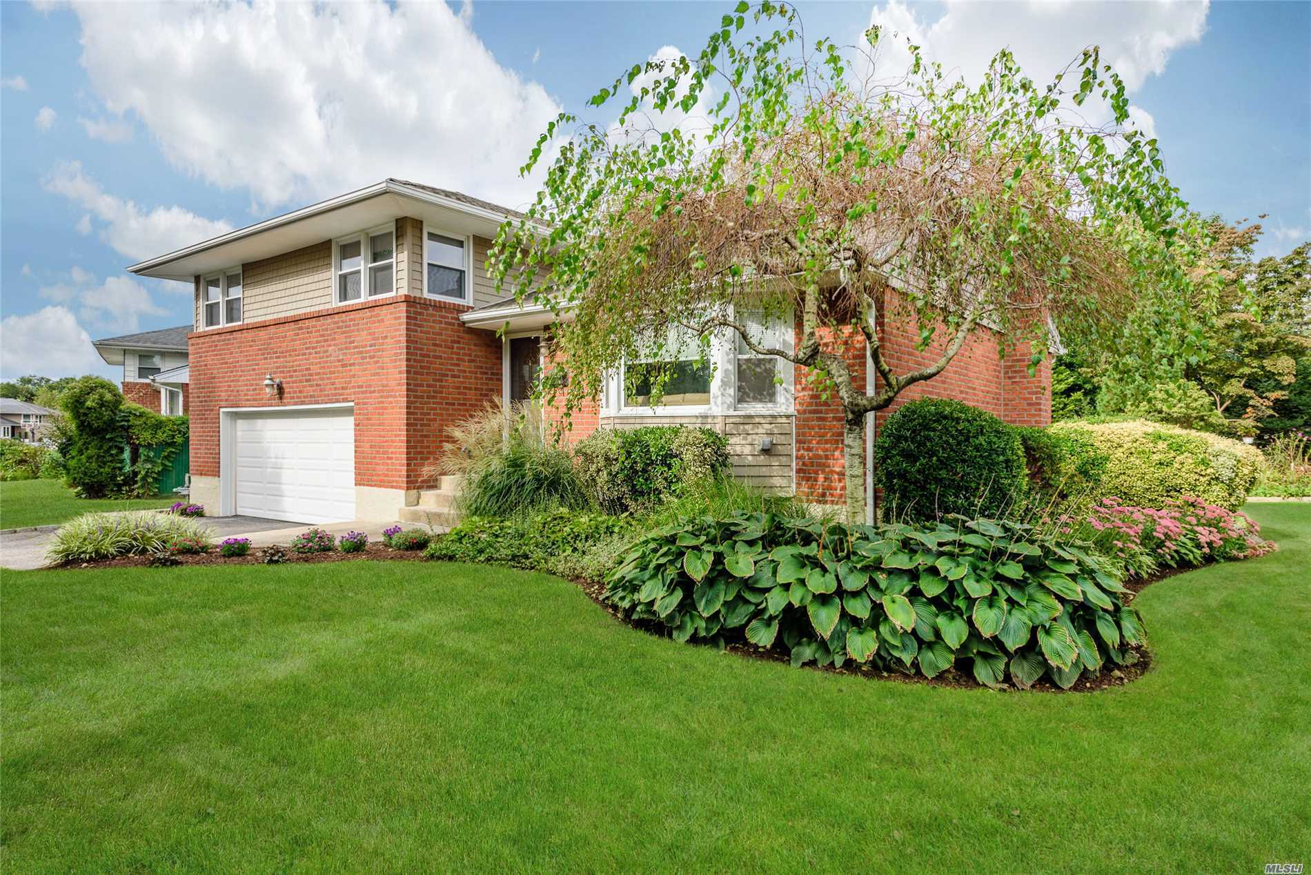 Beautifully Renovated Stylish Split Mid-Block Tree-Lined Location Lush Deep Property. Features 4/3 Bedrooms + 2.5 Baths + Designer Eat In Kitchen 2017 + Master Bath & Powder Room 2018 + 2nd Full Bath Updates 2017 + Huge Den/Bedroom With Out Side Entrance + Lovely Renovated Habitable Finished Basement Great For Extended Family + New Roof + Siding + Brick Repointed + Soffits + Gutters 2017 + Some New Windows 2017 + Cac 2010 + Boiler 2007 + 200 Amp + 2 Car Attached Garage. Solid As A Rock!