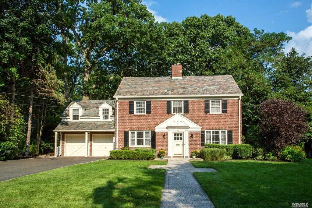 Rare Opportunity! Elegant Chc Ideally Located On A Quiet Cul-De-Sac, Backing On To The Tranquil Park With Pond. This All Brick/Slate Roof Home Boasts Beautiful Formal Rooms, Very Spacious Country Breakfast Area W Doors To Covered Stone Patio, Dramatic Sunken Family Room W/Fpl & Soaring Beamed Ceilings, 4 Bdrms X 3 Full Baths Plus 2 Half Baths, Lower Level W/Fp, Beautifully Landscaped Yard All In A Prime Location, Close To Town & Lirr, Exclusive Shopping.